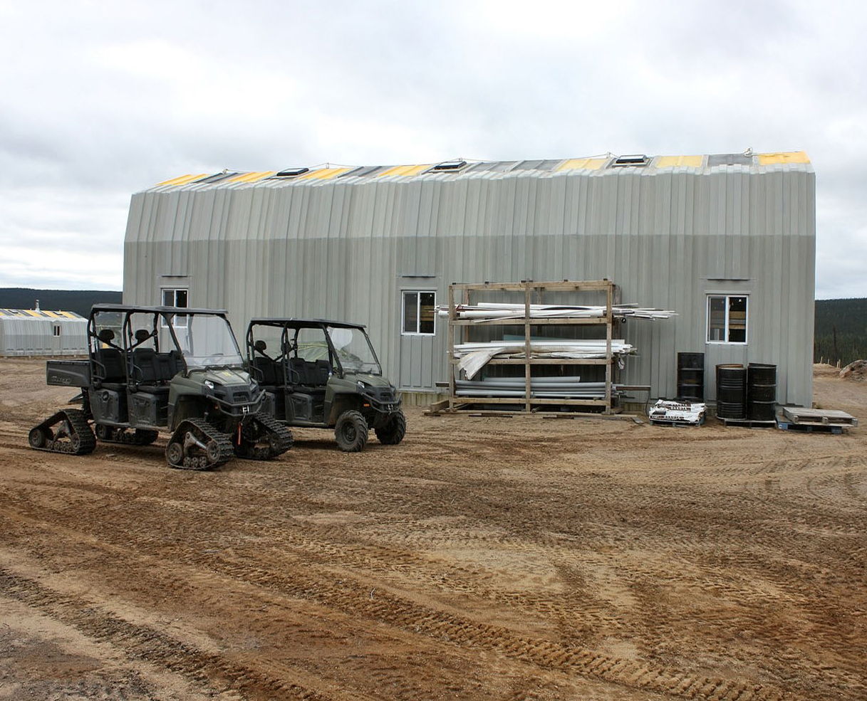 The camp's garages are used to store light machinery and heavy equipment. PHOTO: DND