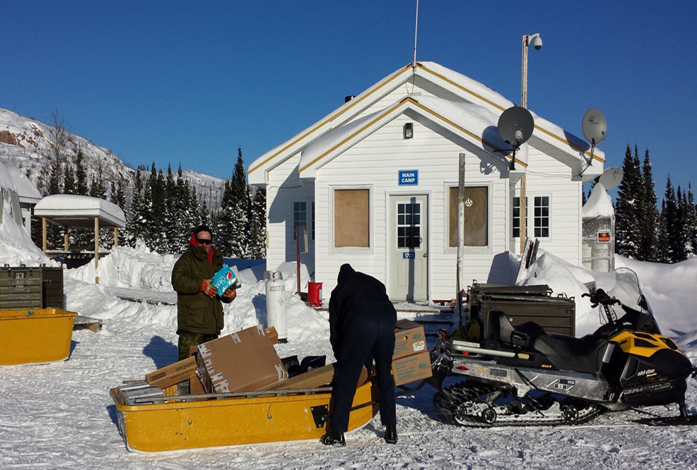 Canadian Rangers unload supplies from a snowmobile sled. Whenever the Practice Training Area is activated, Canadian Rangers are deployed to the camp and become 5 Wing's on-site custodians. PHOTO: DND