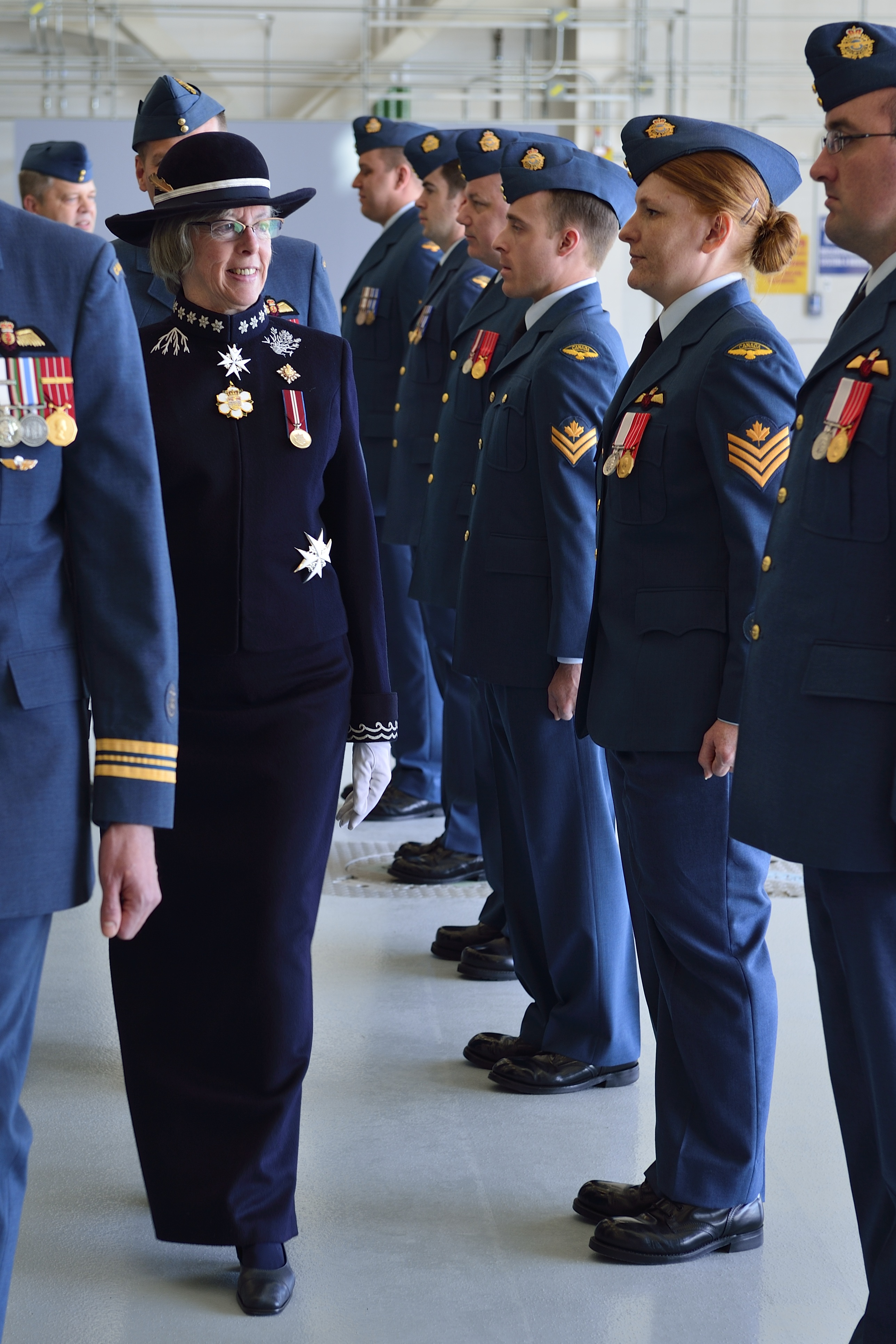 The Honourable Judith Guichon, Lieutenant Governor of British Columbia, inspects members of 443 Maritime Helicopter Squadron during a ceremony to mark the official opening and naming of the squadron's new hangar facility on April 9, 2015. The ceremony included a parade to celebrate the consecration of a new squadron Colour and the unveiling of the new hangar's name. PHOTO: Corporal Malcolm Byers