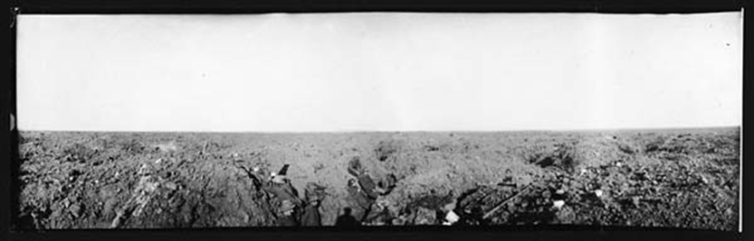 "During the Battle of the Somme, entrenched soldiers of the 1st Battalion, Royal Newfoundland Regiment (centre left) use crude periscopes to look ""over the top"" toward German trenches in the distance. PHOTO: British War Photograph (C.156), National Library of Scotland"