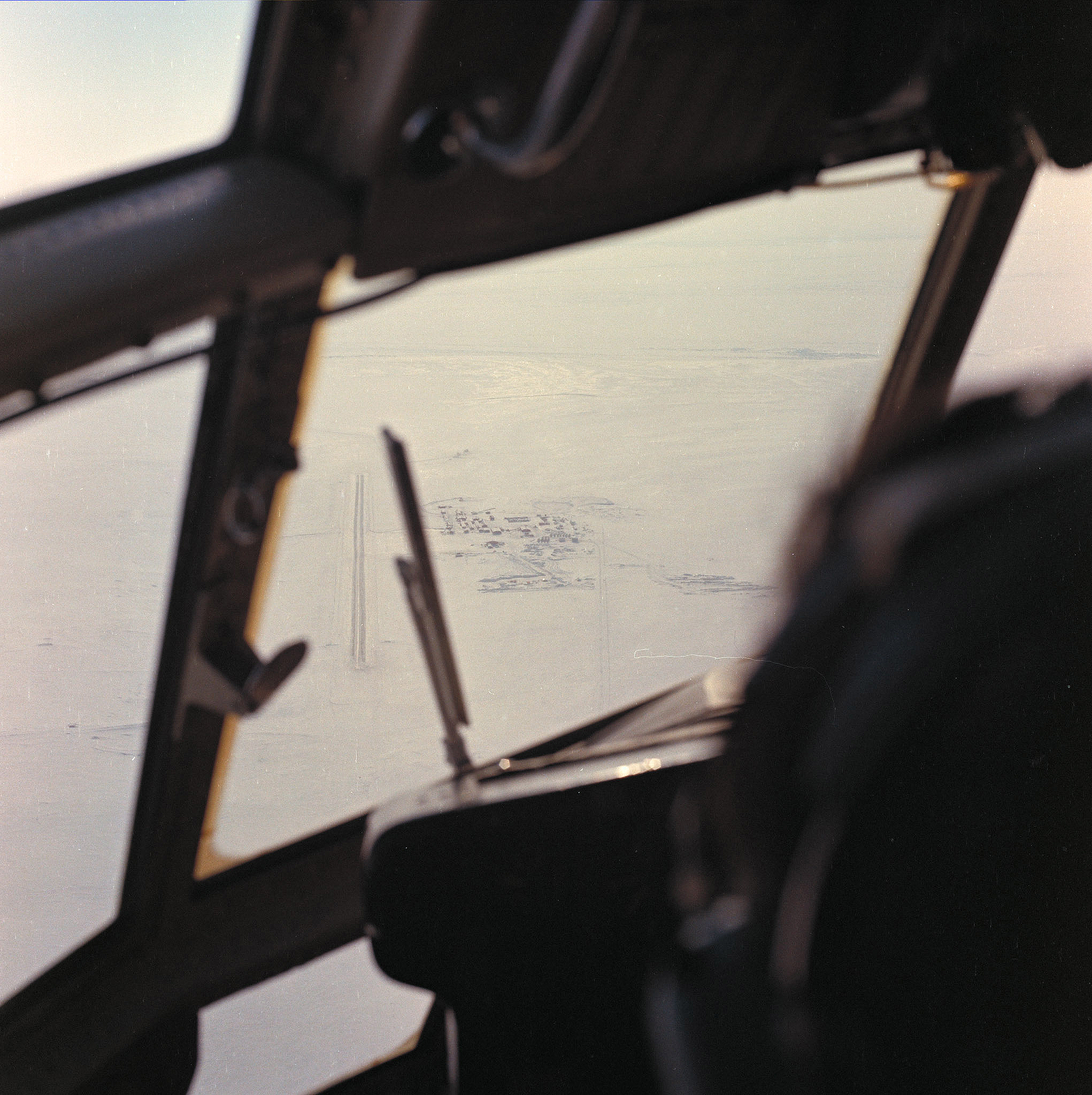 In this undated photograph, the first glimpse of Canadian Forces Station Alert, Nunavut, is seen from the cockpit of a CC-130 Hercules aircraft. PHOTO: DND
