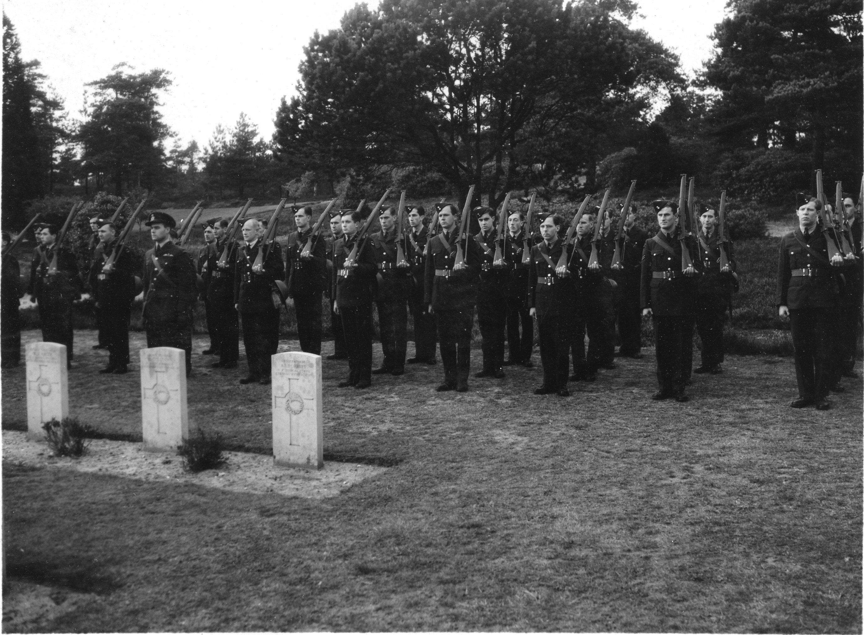A guard of honour from No. 1 Squadron at the burial of a fellow squadron member. PHOTO: Courtesy National Air Force Museum of Canada