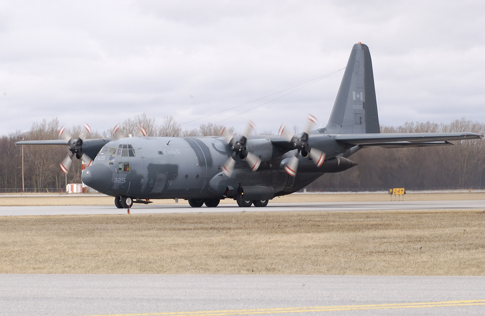 In June 2005, Royal Canadian Air Force CC-130E Hercules No. 325 taxis at 8 Wing Trenton, Ontario. After this Herc was retired in September 2010, all of its potentially dangerous components and its reusable components were removed before it was reduced to scrap for recycling. PHOTO: Private Frieda Van Putten