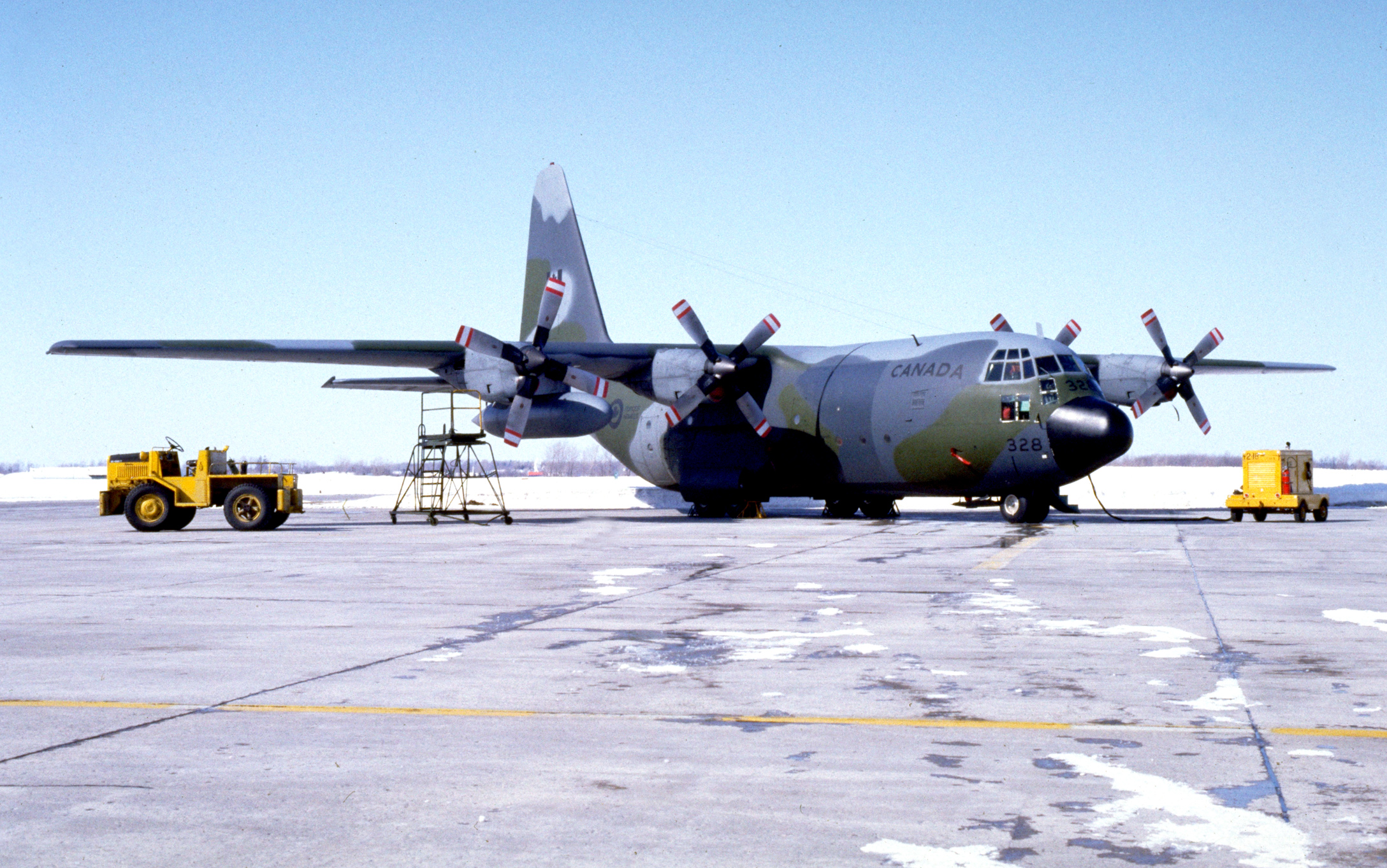 Royal Canadian Air Force CC-130E No. 328 sits on the tarmac at 8 Wing Trenton, Ontario, on December 2006. Retired in October 2011, No. 328 is slated to go to the Greenwood Military Aviation Museum at 14 Wing Greenwood, Nova Scotia. PHOTO: Private Frieda Van Putten