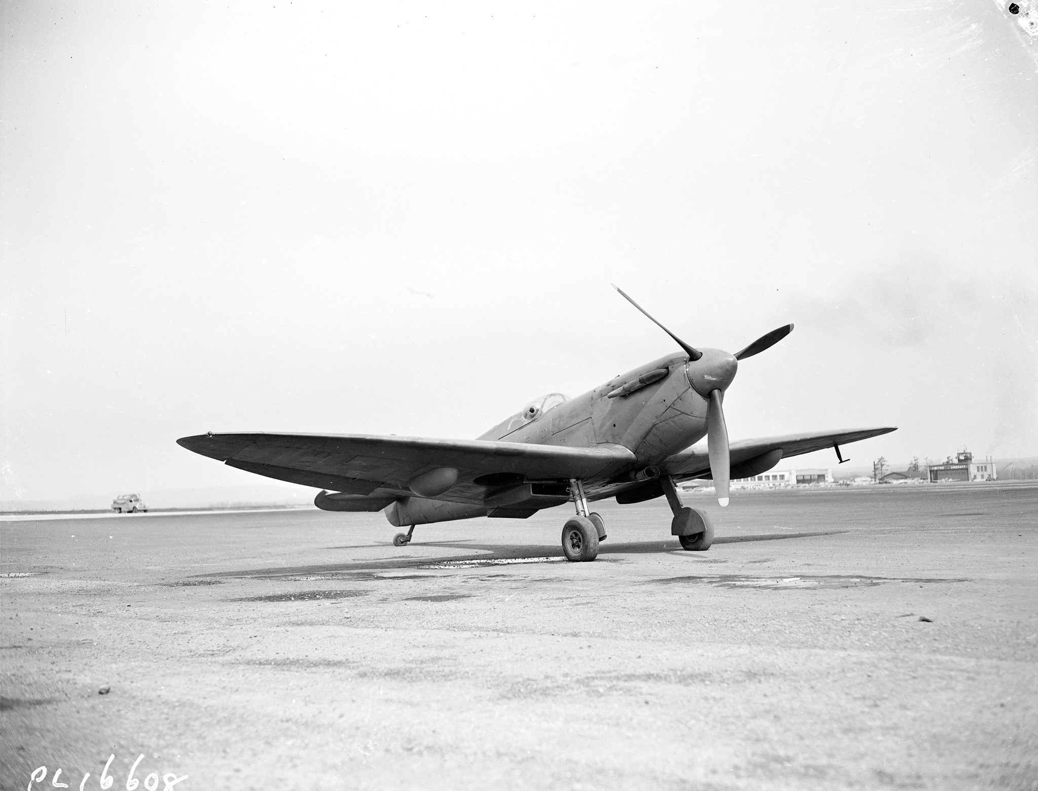 "A Spitfire at rest on May 22, 1943, in an unknown location. ""The Spitfire was difficult to taxi,"" Flying Officer Young said, ""for the long nose rose at a sharp angle when on the ground, and one had to weave from side to side to ensure that all was clear ahead."""