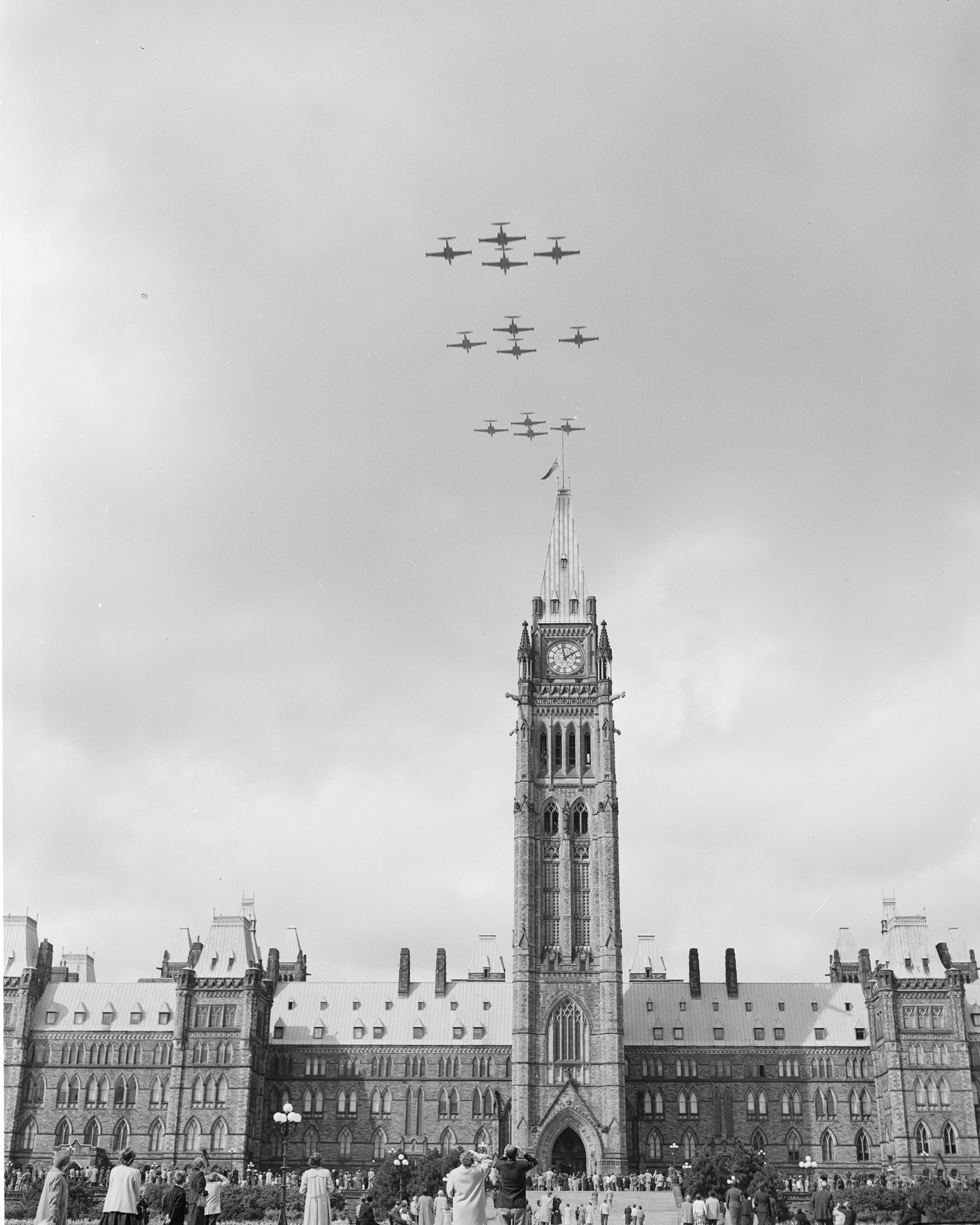 Twelve CF-100 Canuck aircraft fly over the Peace Tower during the Battle of Britain ceremony held in Ottawa on September 16, 1956. PHOTO: PL-105191, DND Archives