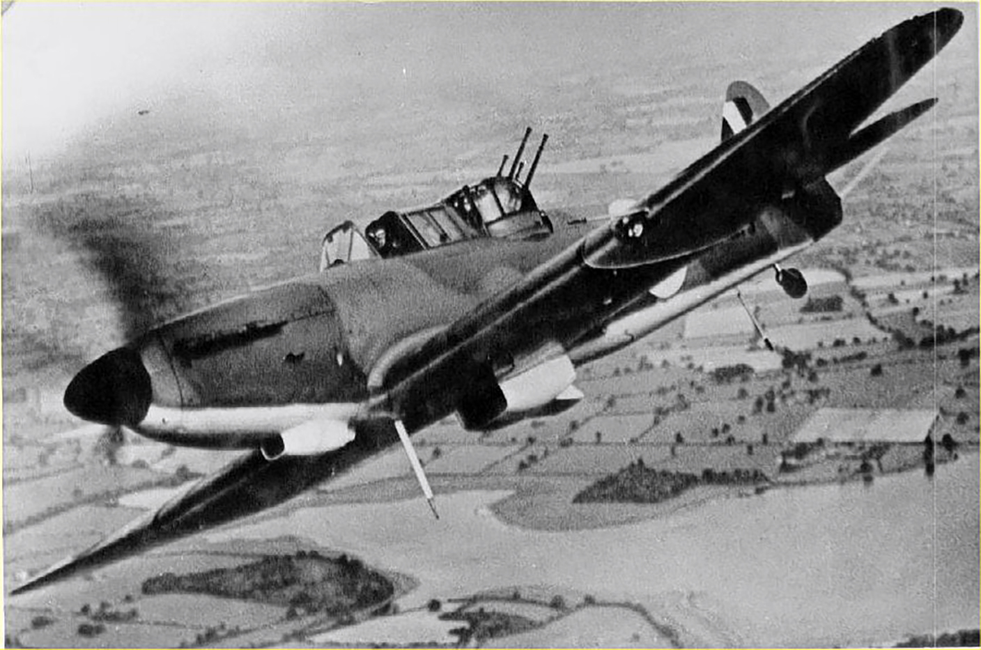 A Boulton Paul Defiant flies over a river basin. The aircraft's three-bladed all-metal, variable-pitch airscrew was driven by a Rolls Royce Merlin engine operating at a speed of 300 miles per hour [483 kilometres per hour]. The Oleo-pneumatic undercarriage retracted sideways into the wing centre portion. PHOTO: Royal Air Force