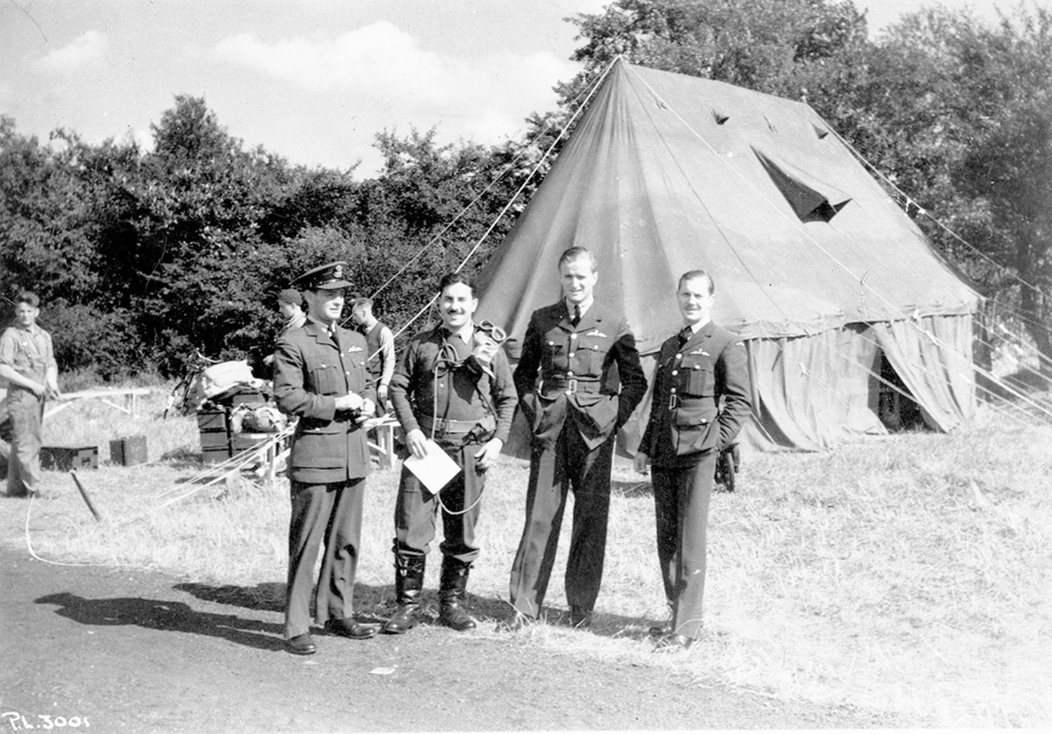 In 1940, Royal Canadian Air Force No. 1 (Fighter) Squadron members Flying Officer Otto John Peterson, Flying Officer Jean-Paul Joseph Desloges, Flying Officer Paul Brooks Pitcher and Flying Officer Hartland de Montarville Molson stand outside a tent at Royal Air Force Northolt, South Ruislip, in the London borough of Hillingdon. PHOTO: DND