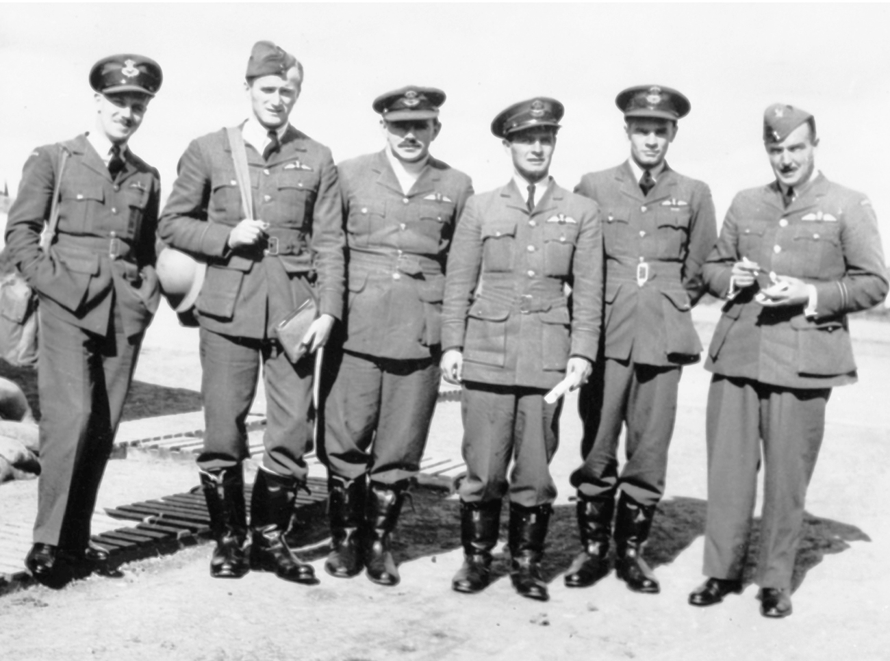 Flying Officer Hartland de Montarville Molson (left), Flying Officer Paul Brooks Pitcher, Flying Officer Peter Locknan, Flying Officer Otto John Peterson, Flying Officer Charles Warren Trevena, and Flying Officer Gordon Roy McGregor, all pilots with Royal Canadian Air Force No. 1 (Fighter) Squadron, are stationed at Royal Air Force Northolt, South Ruislip, in the London borough of Hillingdon In 1940. PHOTO: DND