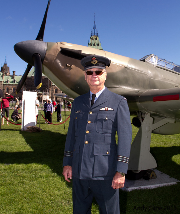 Retired Lieutenant-Colonel Chris Colton, executive director of the National Air Force Museum of Canada, located in Trenton, Ontario, donned a vintage Royal Canadian Air Force uniform for the national Battle of Britain ceremony in Ottawa on September 20, 2015. He spent several hours standing before a replica Second World War Hawker Hurricane aircraft on the lawn of Parliament Hill to share information about the iconic aircraft with members of the public. PHOTO: © Andy Cline, used with permission