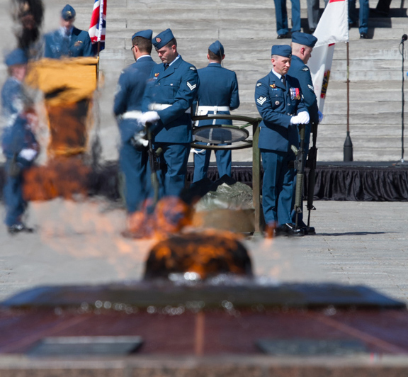 With the Centennial Flame in the foreground, sentries stand at rest with arms reversed around the Cenotaph on Parliament Hill during the national ceremony held September 20, 2015, to mark the 75th anniversary of the Battle of Britain. PHOTO: © Andy Cline, used with permission