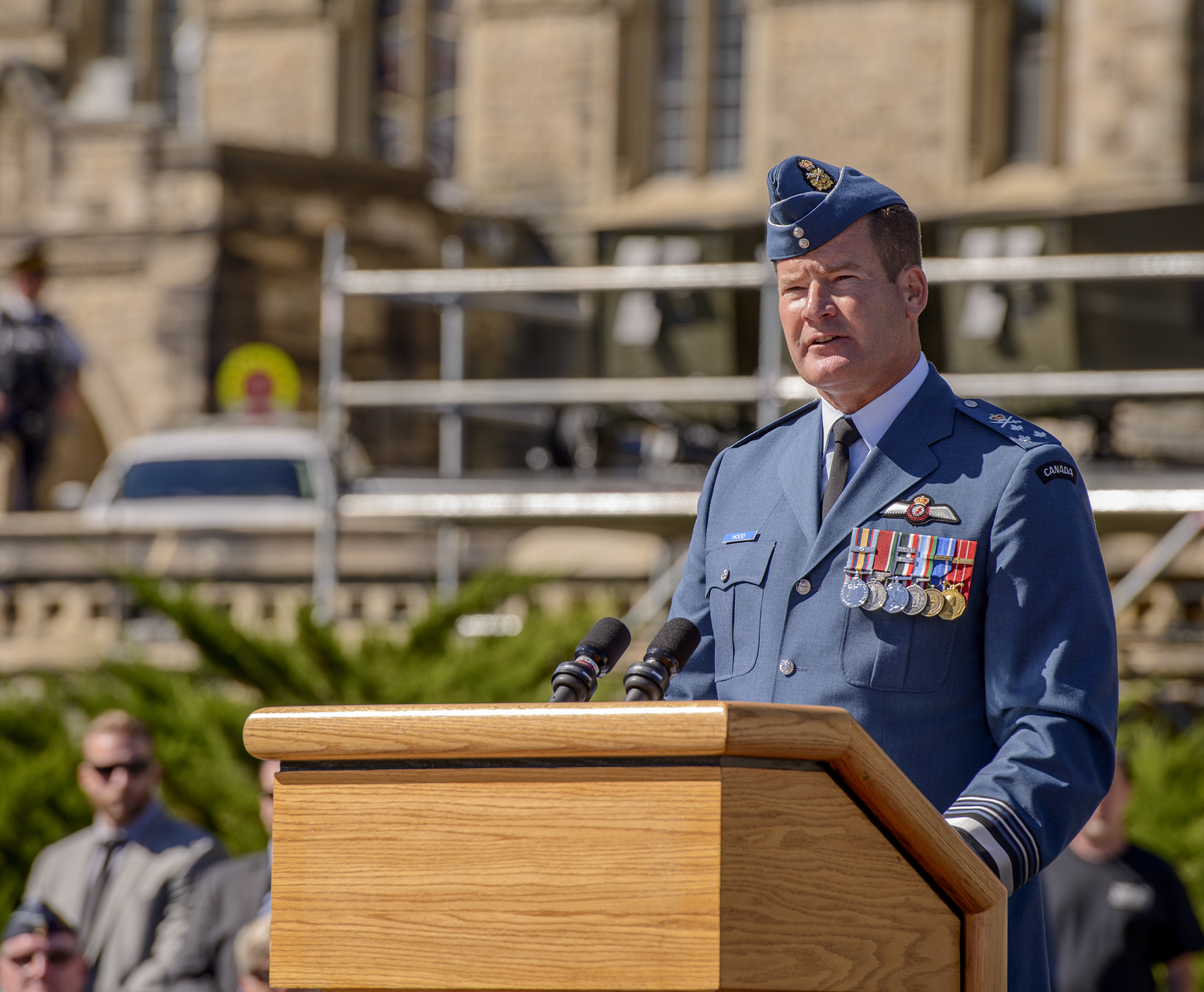 "Lieutenant-General Michael Hood speaks during the national Battle of Britain 75th anniversary ceremony held on Parliament Hill in Ottawa on September 20, 2015. ""As we honour their bravery, we must remember that our freedom is built upon their valour, and give thanks for their courage and sacrifice,"" he said. PHOTO: Master Corporal Daniel Merrell"