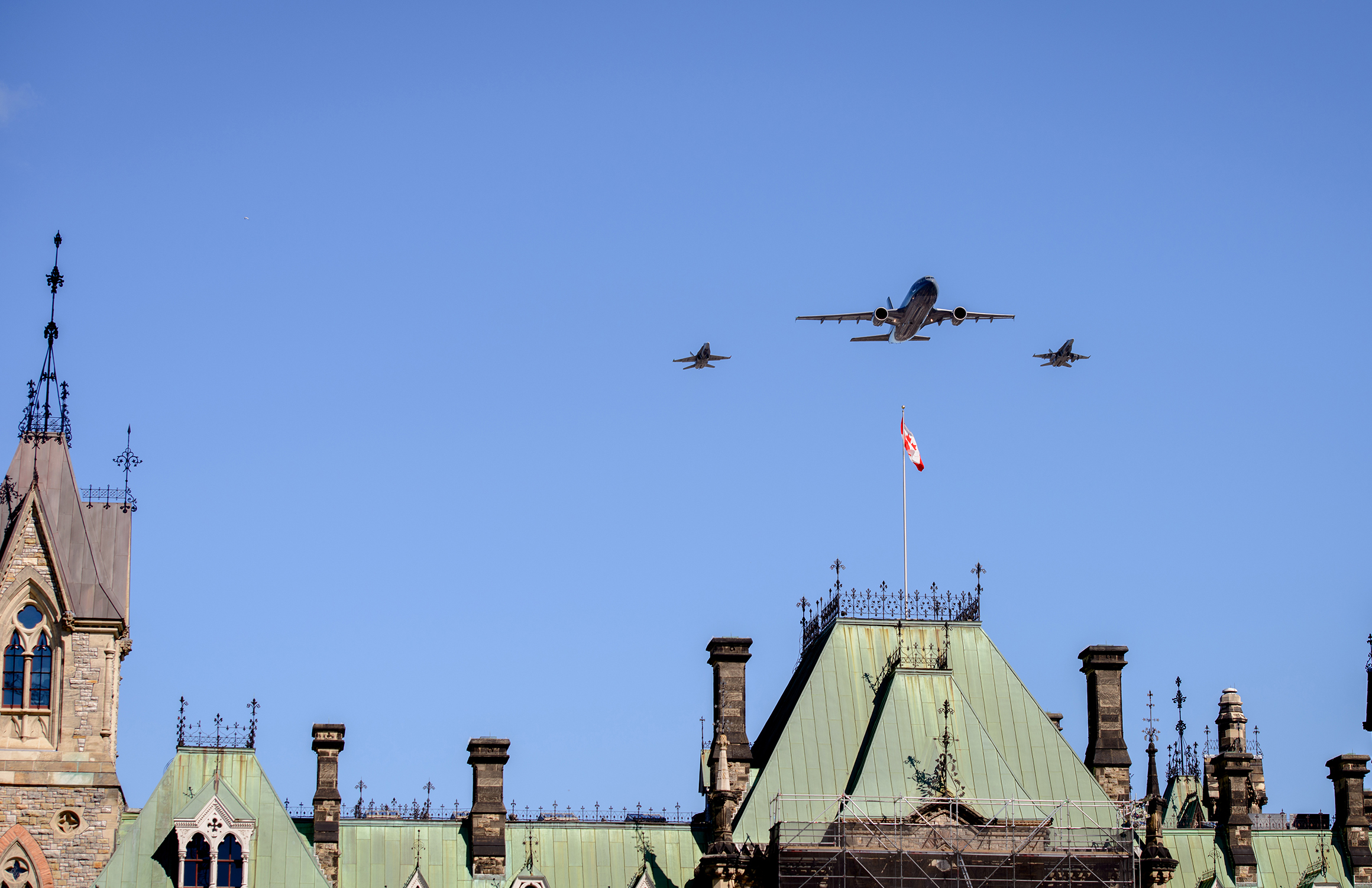 A CC-150 Polaris, flanked by two CF-188 Hornets, flies over Parliament Hill during the national ceremony held September 20, 2015, to mark the 75th anniversary of the Battle of Britain. PHOTO: Master Corporal Daniel Merrell