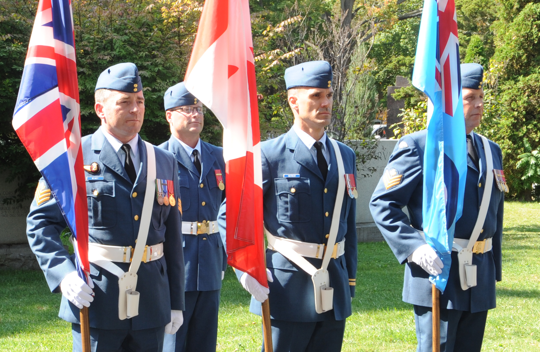 The colour party stands during the ceremony. PHOTO:  Master Corporal Clesse Howse