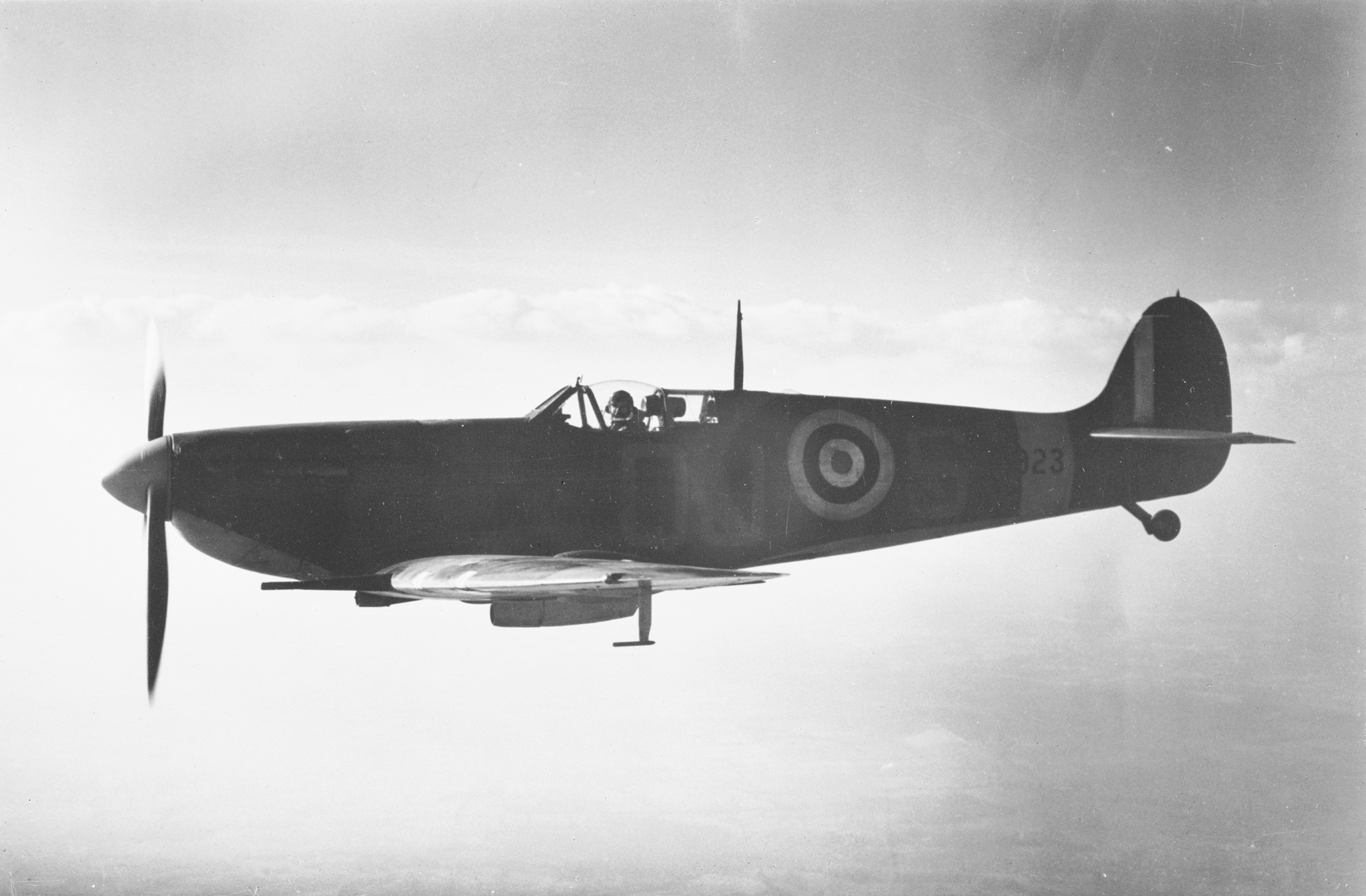 A Supermarine Spitfire similar to the aircraft flown by Pilot Officer Magee with No. 412 (Fighter) Squadron, RCAF, at RAF Digby, Lincolnshire, during the Second World War, in flight in October 1941. PHOTO: DND Archives
