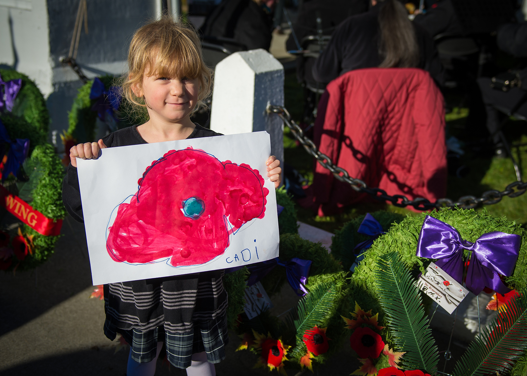 During the Remembrance Day ceremony held in the village of Cumberland, British Columbia, on November 11, 2015, Cadence Herron displays the drawing she made to commemorate Canadians who have fought and continue to fight for freedom. PHOTO: Corporal Pierre Létourneau