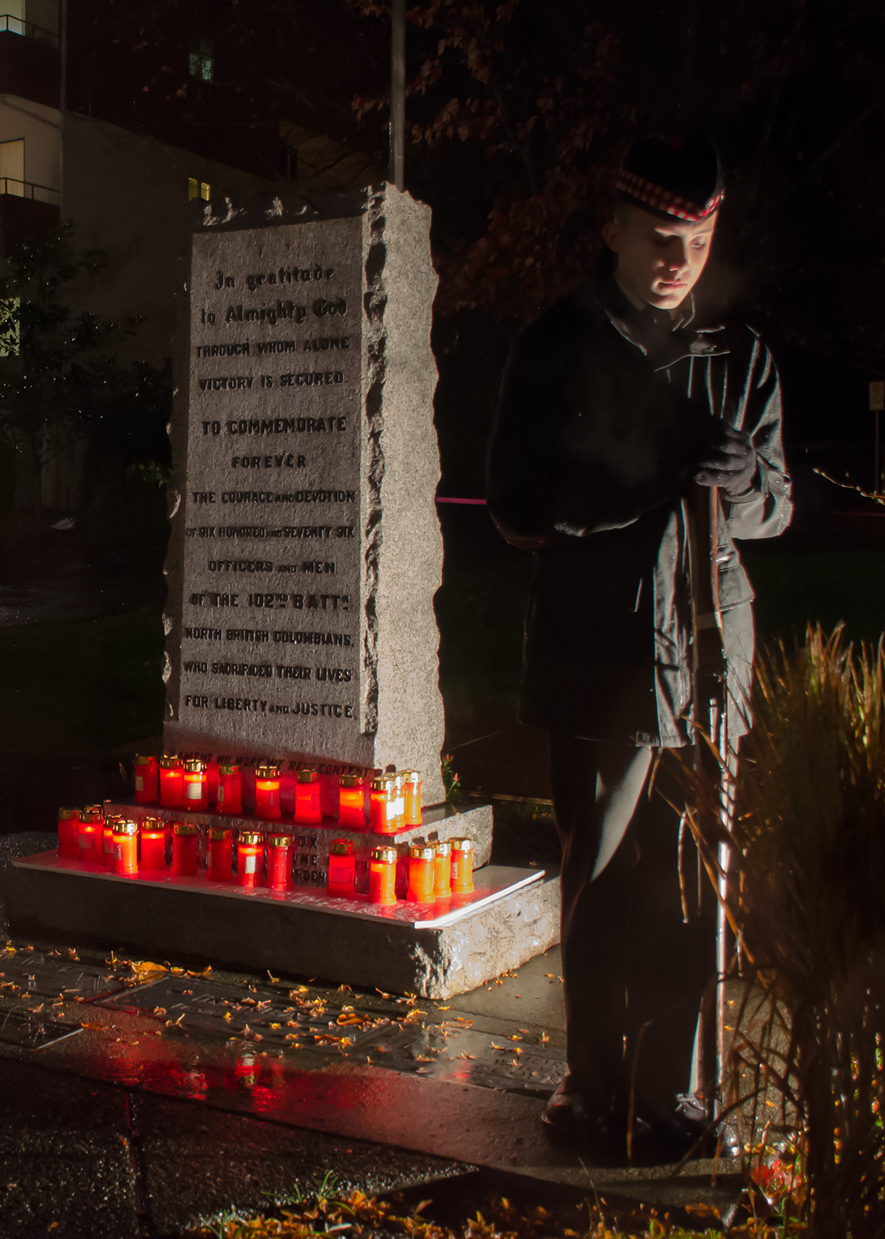 Cadet Warrant Officer Paul LeClere stands vigil at the Comox, British Columbia, cenotaph following a candlelight ceremony on November 10, the eve of Remembrance Day 2015.