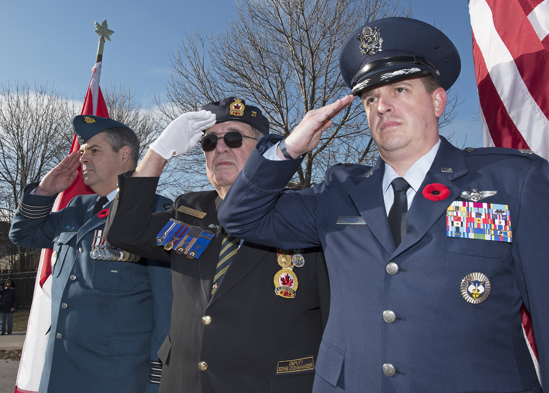 22 Wing commander Colonel Henrik Smith (front); Mr. Preston Quirt, Royal Canadian Legion Branch 23 Deputy Zone commander; and 22 Wing operations officer Lieutenant-Colonel Michael Harmon, salute as the Remembrance Day parade marches past. 22 Wing North Bay, Ontario, marked Remembrance Day at North Bay's Memorial Gardens Arena. PHOTO: Corporal Joseph Morin