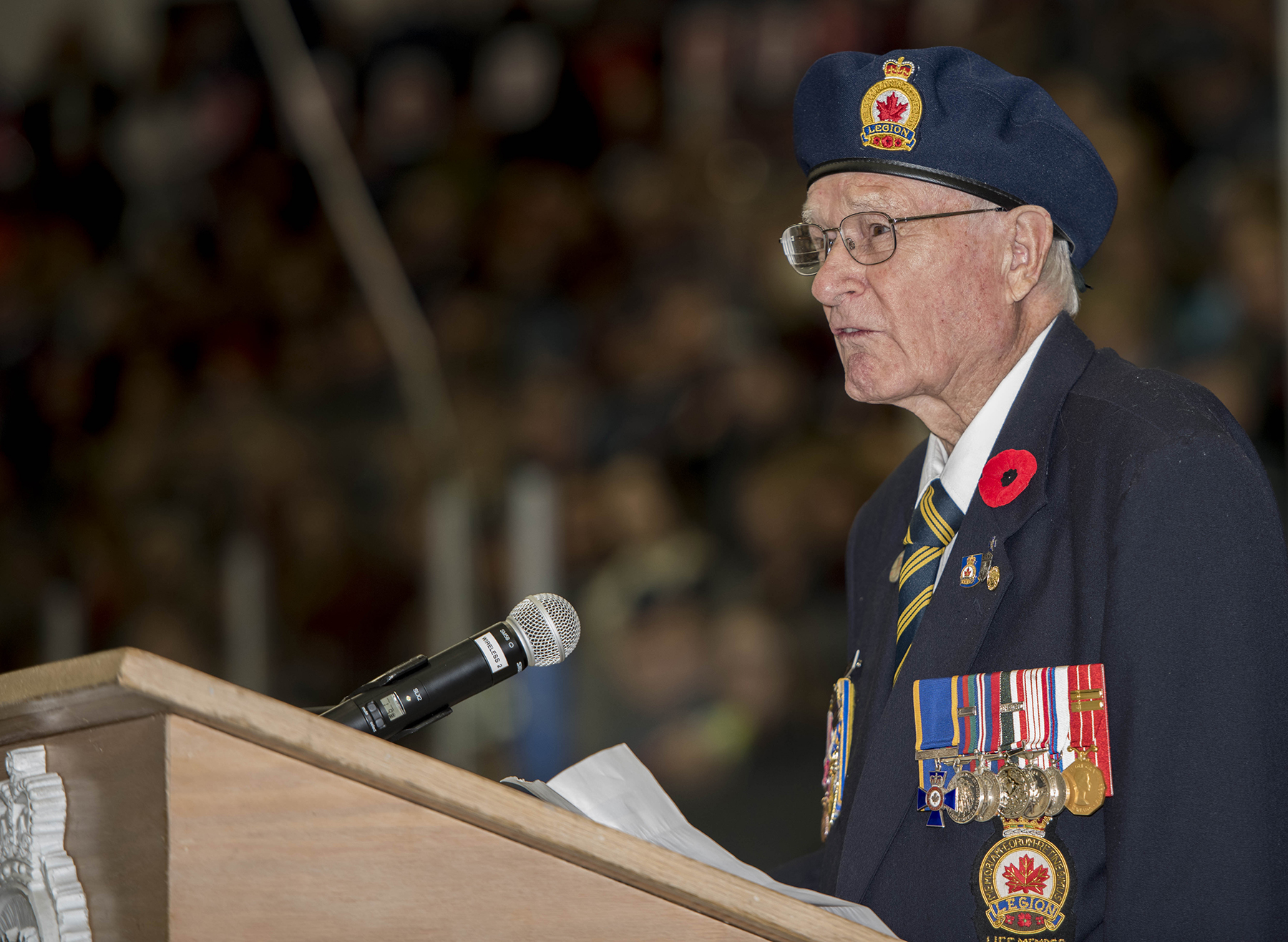 "Royal Canadian Legion Branch 211 veteran Donald Dygert reads ""In Flanders Fields"" to those attending the 4 Wing Cold Lake, Alberta, Remembrance Day ceremony held November 11, 2015, at the Cold Lake Energy Centre. PHOTO: Corporal Manuela Berger"