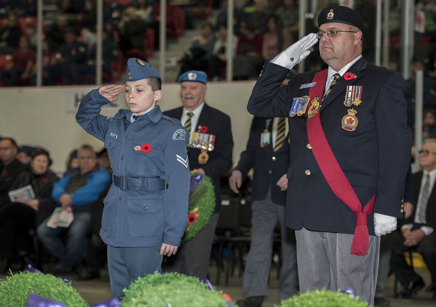 A member of Cold Lake Royal Canadian Air Cadet Squadron 664 salutes after laying a wreath during the 4 Wing Remembrance Day ceremony held at the Energy Centre in Cold Lake, Alberta on November 11, 2015. PHOTO: Corporal Manuela Berger