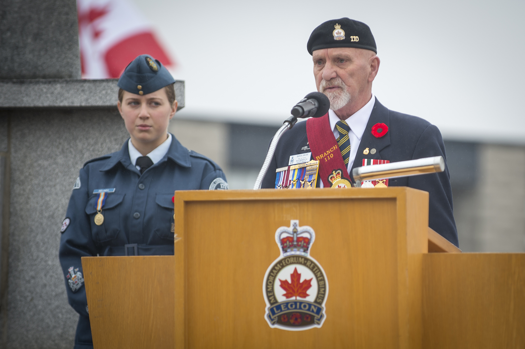 "Doug Duff, a veteran from Royal Canadian Legion Branch #100 Trenton, recites the ""Act of Remembrance"" during the 2015 Remembrance Day ceremony held in Trenton, Ontario, on November 11, 2015. PHOTO: Master Corporal Mathieu St-Amour"