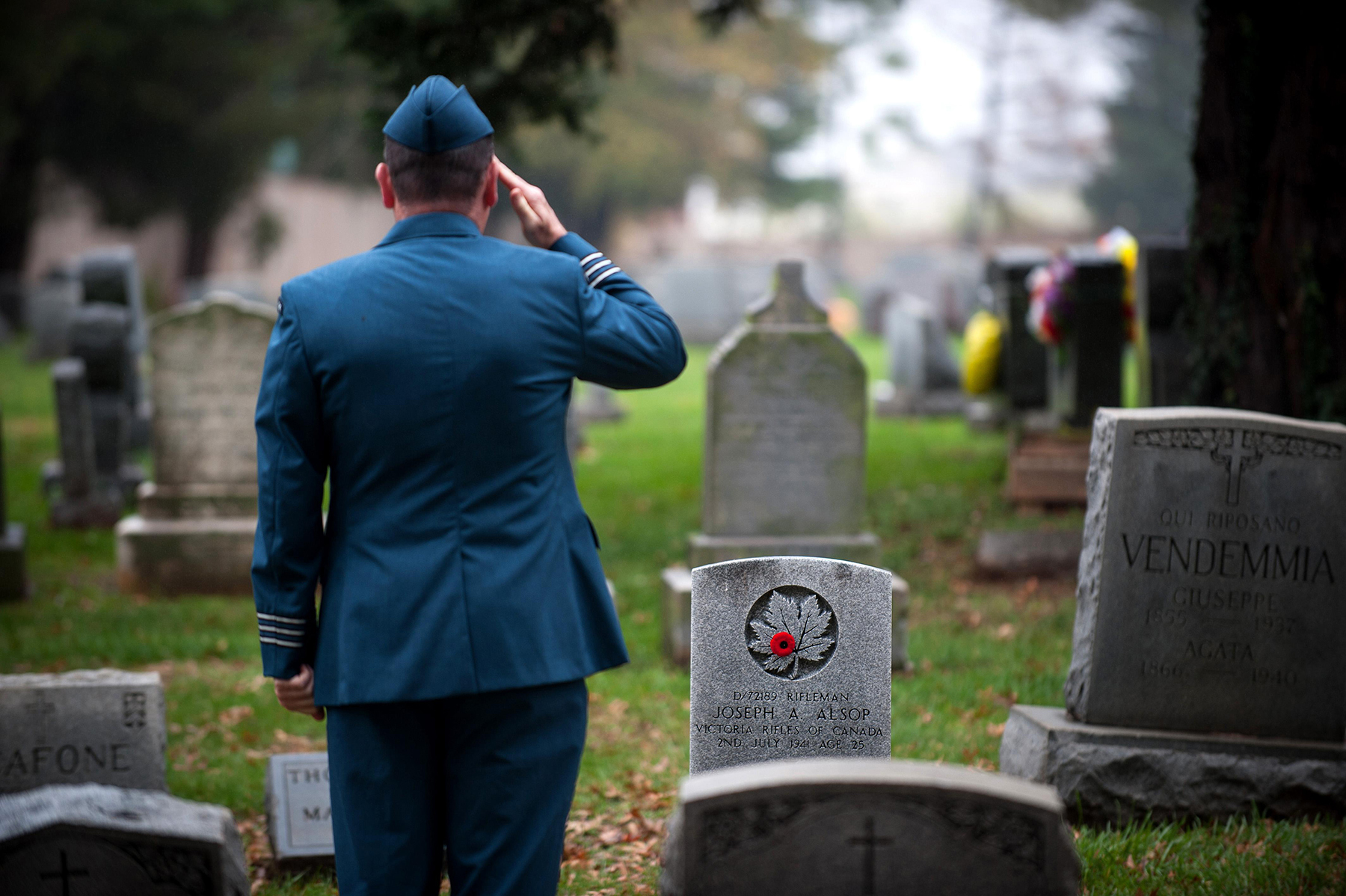 During Remembrance Week 2015, Lieutenant-Colonel Dave Devenney, Canadian Defence Liaison Staff (Washington), pays his respects to Rifleman Joseph A. Alsop, a member of the Victoria Rifles of Canada, who died on July 2, 1941, and to other Canadian military personnel interred in Arlington National Cemetery in Arlington, Virginia, U.S. PHOTO: Keegan Bursaw