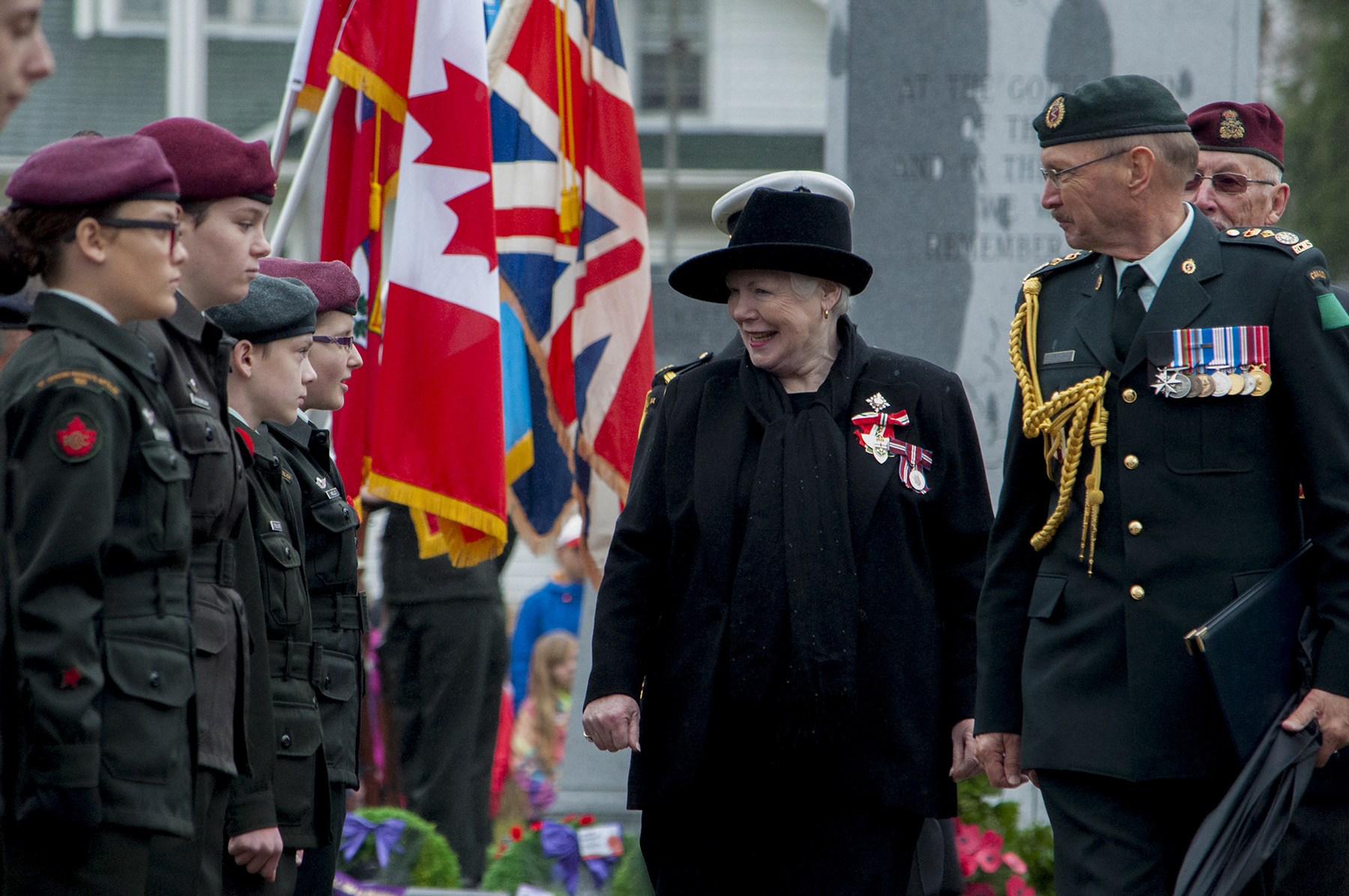 Accompanied by Honorary Lieutenant-Colonel Ian Sutherland, Lieutenant Governor of Ontario Elizabeth Downdeswell greets members of 1 Canadian Parachute Battalion Cadet Group, 8 Wing Trenton's Aerospace Telecommunication and Engineering Support Squadron, and Legion Branch #100 following the November 11, 2015, Remembrance Day ceremony in Brighton, Ontario. PHOTO: Natalie Wannamaker