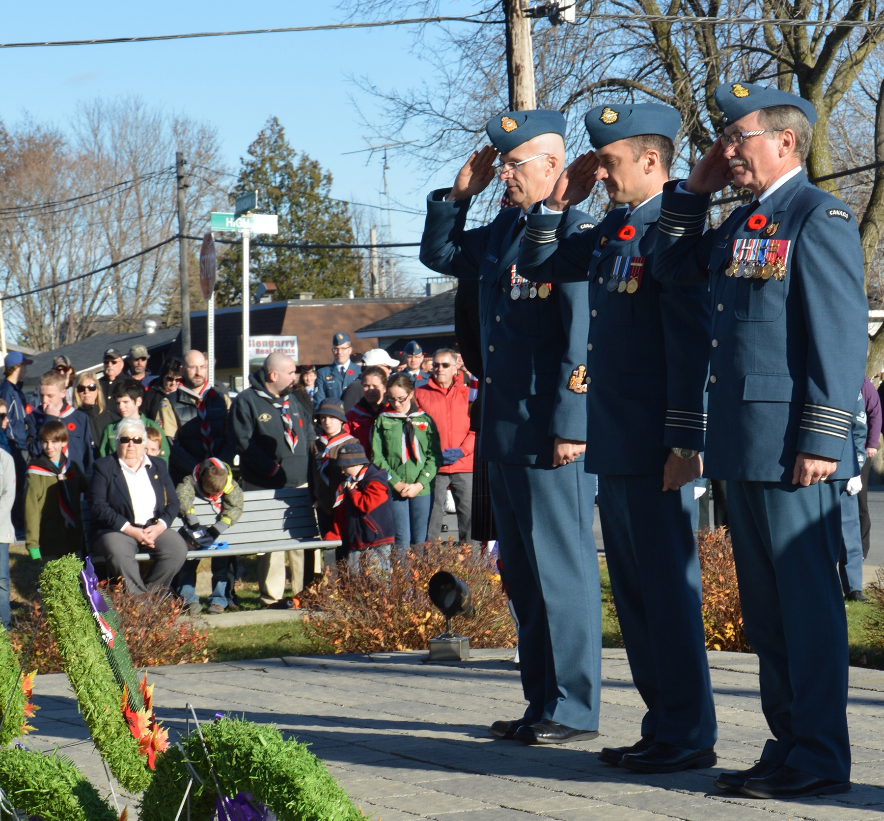 Chief Warrant Officer Michel Bonneau (left), Canadian Forces School of Aerospace Control Operations (CFSACO) chief warrant officer, CFSACO commanding officer Lieutenant-Colonel Steeve Caron, and CFSACO's Honorary Colonel Robert Chekan salute after placing a wreath during the Remembrance Day ceremony in Cornwall, Ontario. PHOTO: DND