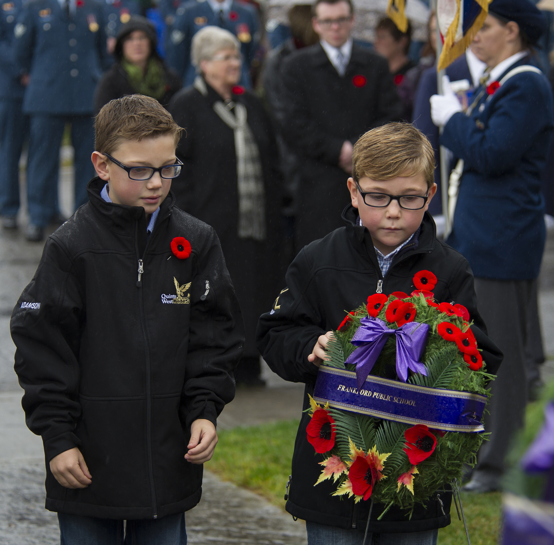 The Adamson brothers approach the cenotaph to place a wreath on behalf of Frankford Public School at the Remembrance Day Ceremony in Frankford, Ontario, on November 11, 2015. PHOTO: Aviator Ryan Moulton