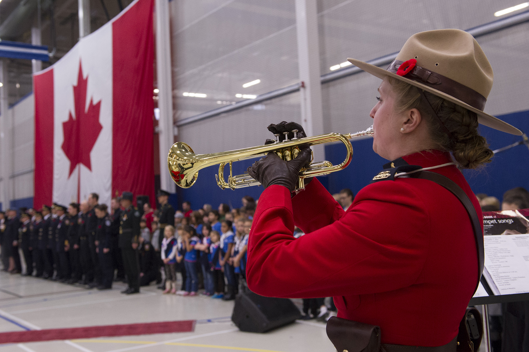 "Royal Canadian Mounted Police trumpeter Constable Allison Moore sounds ""Last Post"" during the November 11, 2015, Remembrance Day ceremony in Lac La Biche, Alberta. PHOTO: Master Corporal Heather MacRae"