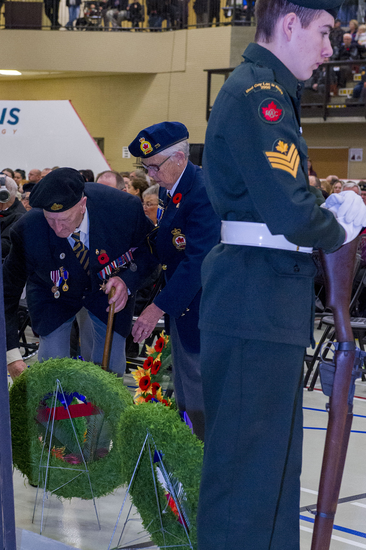 Second World War veteran Glen Meyers (left) places a wreath in memory of a fallen comrade during the Remembrance Day ceremony held in Lac La Biche, Alberta, on November 11, 2015. PHOTO: Master Corporal Heather MacRae