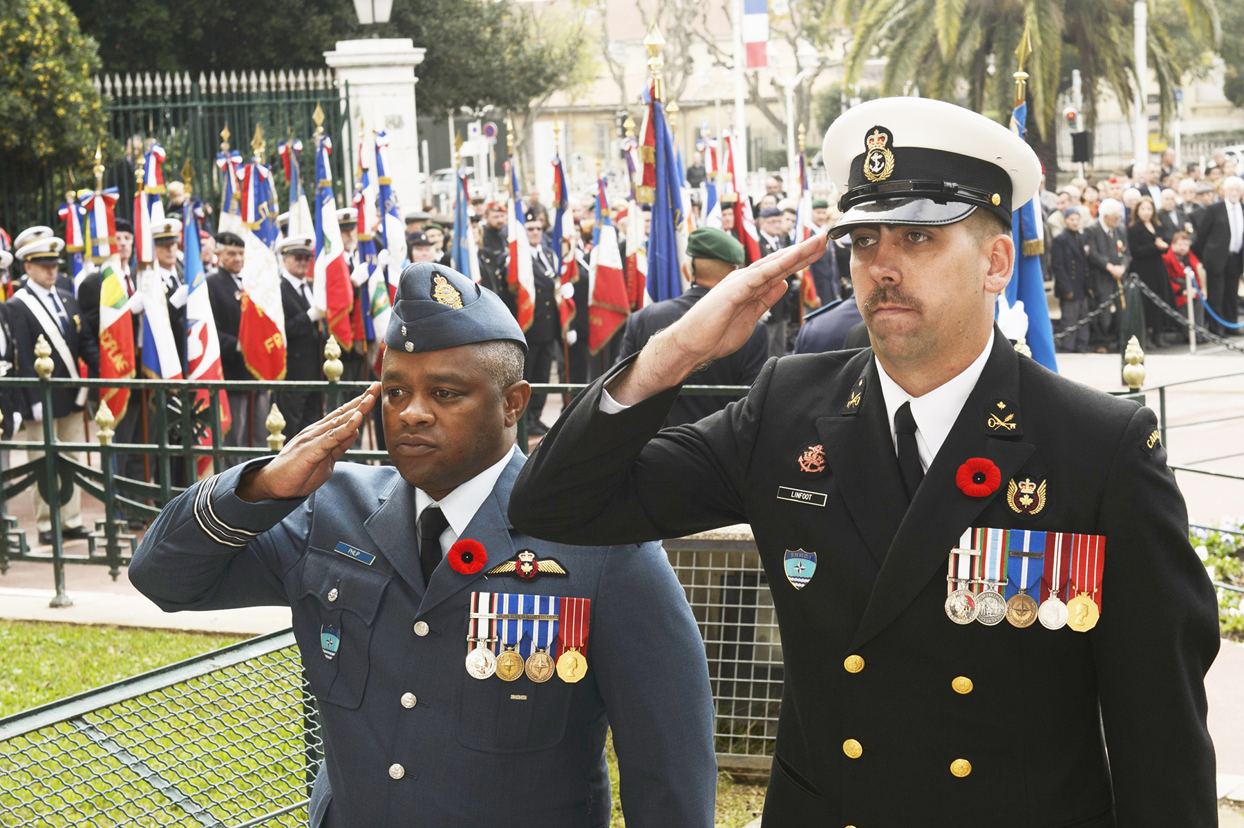 Major Don Philip, the acting air officer on board Her Majesty's Canadian Ship Winnipeg, and Petty Officer 1st Class Trevor Linfoot, ship's senior steward, both deployed on Operation Reassurance, salute after placing a wreath on behalf of the ship's commanding officer and crew at the cenotaph during the November 11, 2015, Remembrance Day ceremony in Toulon, France. PHOTO: Corporal Stuart MacNeil