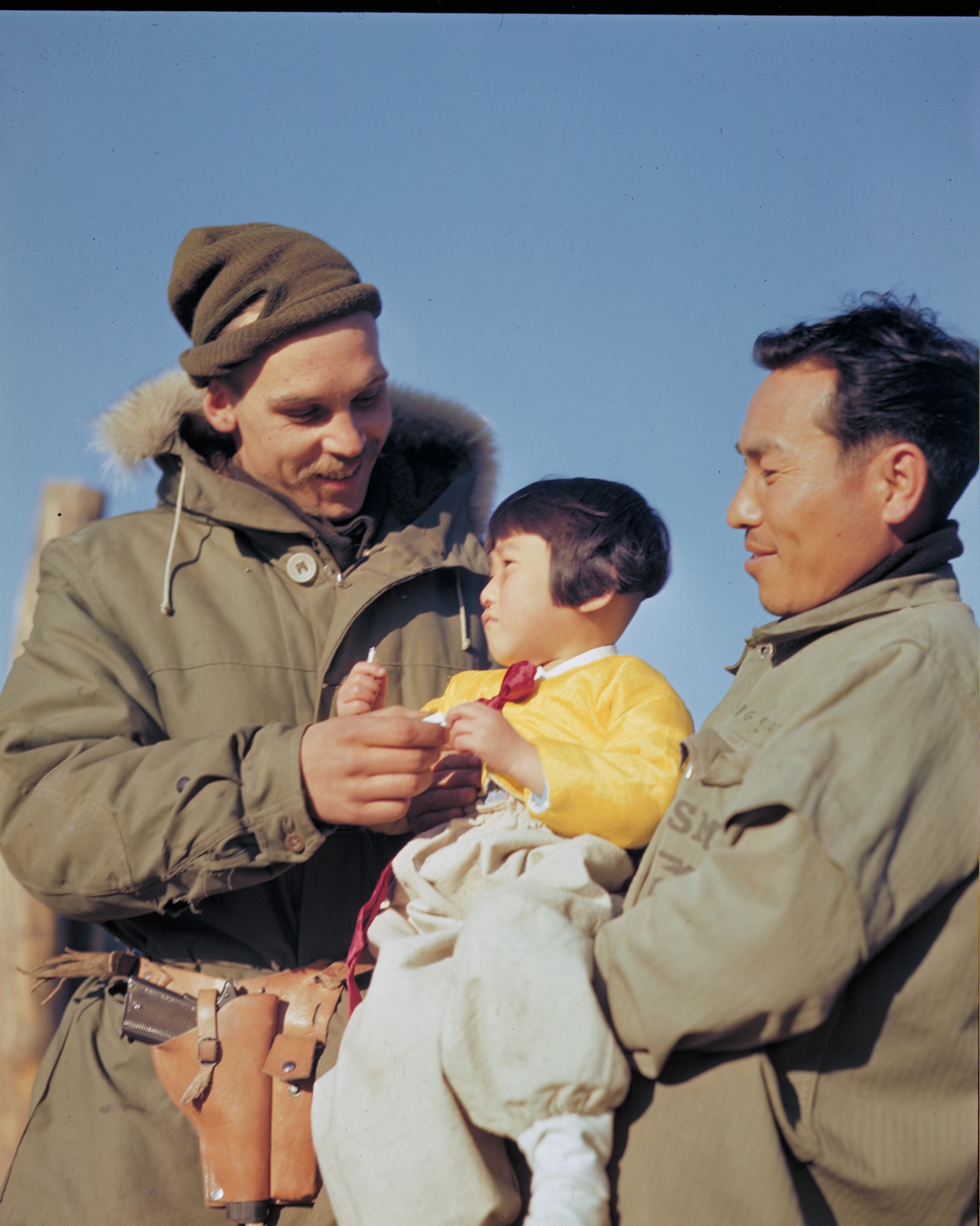 A soldier from 2nd Battalion, Princess Patricia's Canadian Light Infantry, gives sweets to a South Korean child. PHOTO: DND Archives