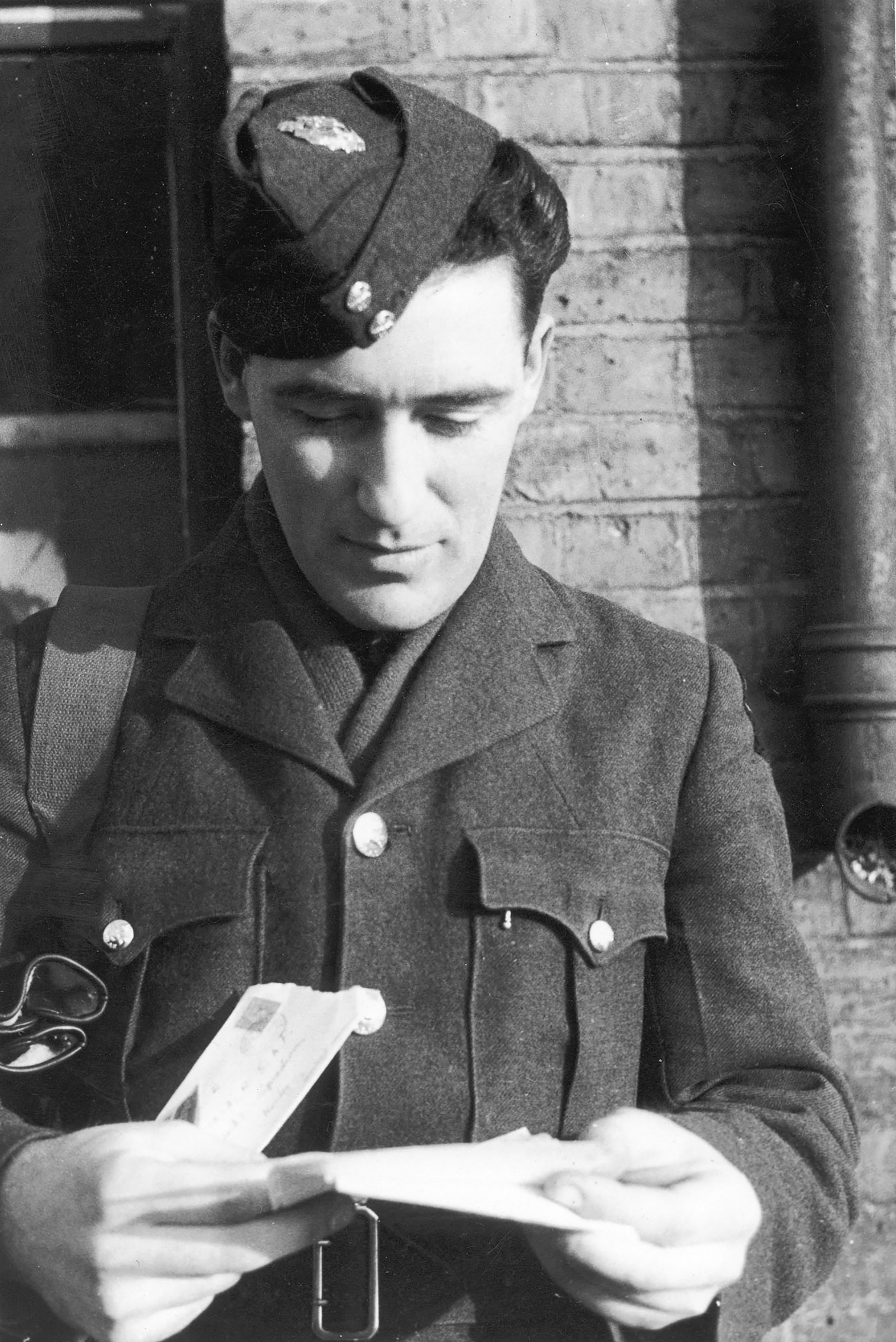 Leading Aircraftman Ross Coleman (Winnipeg, Manitoba) is lost in a letter from home on March 23, 1943. The letter arrived while his Spitfire Squadron was on manoeuvres. Mail from home was always the most welcome event of the day.