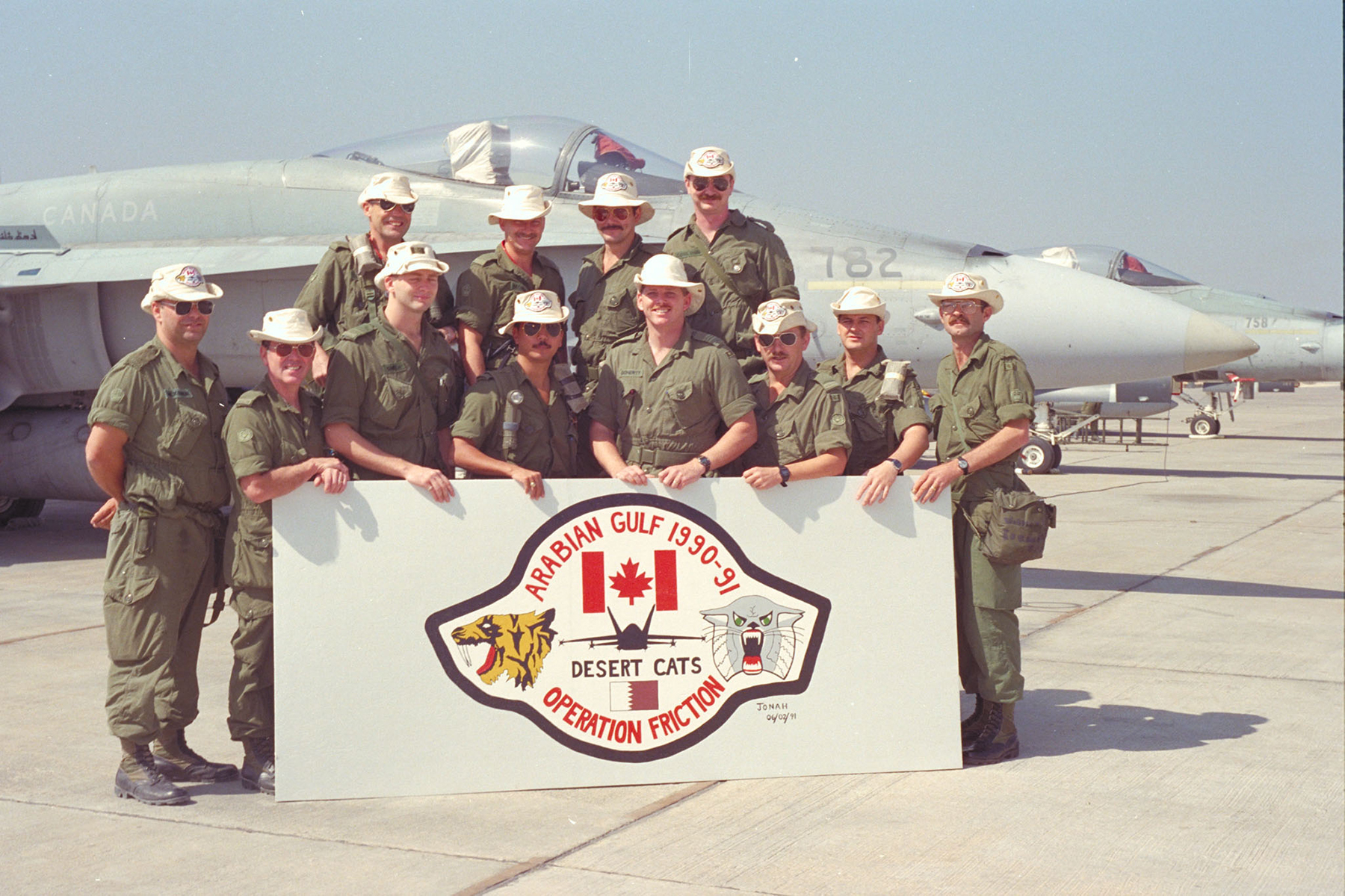 "Senior non-commissioned officers and officers from the ""Desert Cats"" groundcrew pause for a photo in Qatar during Operation Friction, Canada's contribution to the first Gulf War."