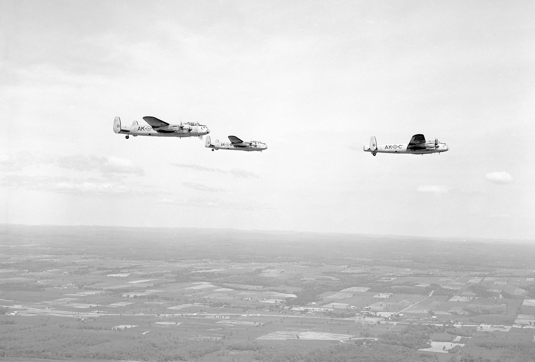 Three Lancaster bombers from 408 Squadron fly over RCAF Station Rockcliffe, near Ottawa, Ontario, on May 28, 1953. PHOTO: DND Archives