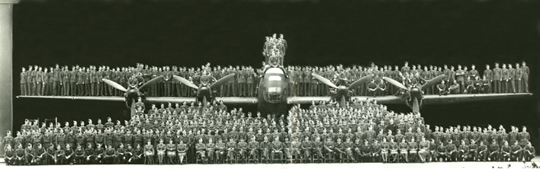 Molly Rayner and all of her co-workers with Royal Canadian Air Force 408 Bomber Squadron Overseas – pilots, aircrew, groundcrew, and support personnel – gather on and in front of a 408 Squadron Halifax bomber in October 1942. PHOTO: Bomber Command Museum