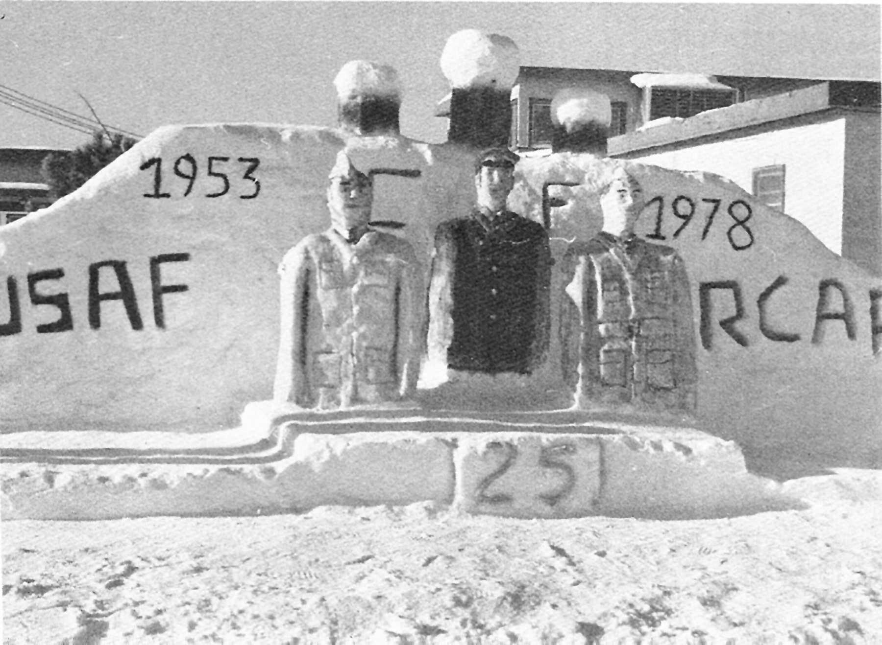 Winter carnivals were a way to break the monotony of winter at the often-remote radar stations. This elaborate snow sculpture at RCAF Station Sioux Lookout, Ontario, celebrates the 25th anniversary of the station, portraying three uniformed personnel against a background topped by radar domes. PHOTO: Canadian Forces Museum of Aerospace Defence collection
