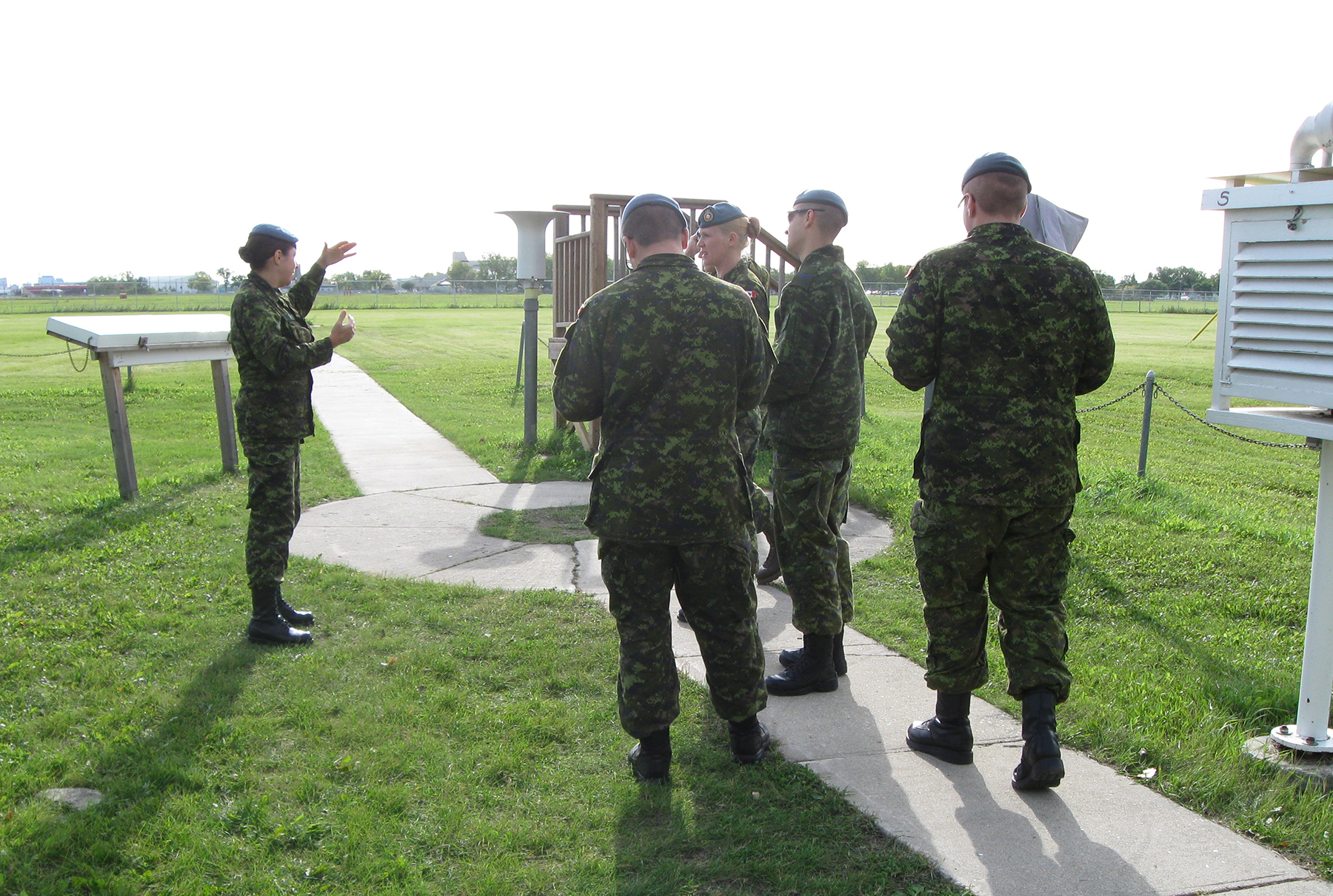 Royal Canadian Air Force meteorology technician Sergeant Caroline Linteau walks her students through the various weather measurement and tracking tools at the Canadian Forces School of Meteorology in Winnipeg, Manitoba. PHOTO: Courtesy Sergeant Caroline Linteau