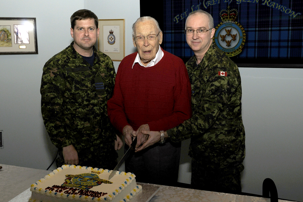 On January 15, 2015, Lieutenant-Colonel Marc Rodgers, commander of 16 Wing Borden, Flight Lieutenant (retired) Glen Rawson and Colonel Carl Doyon,  commander of Canadian Forces Base Borden, cut a birthday cake to celebrate Flight Lieutenant Rawson's 98th birthday.  In 1940, Flight Lieutenant Rawson graduated from the first pilot's course conducted under the newly formed British Commonwealth Air Training Plan. That training took place in Borden, with some of his training occurring in the same building where his 98th birthday celebrations were held. PHOTO: DND, BM2015-2000-02