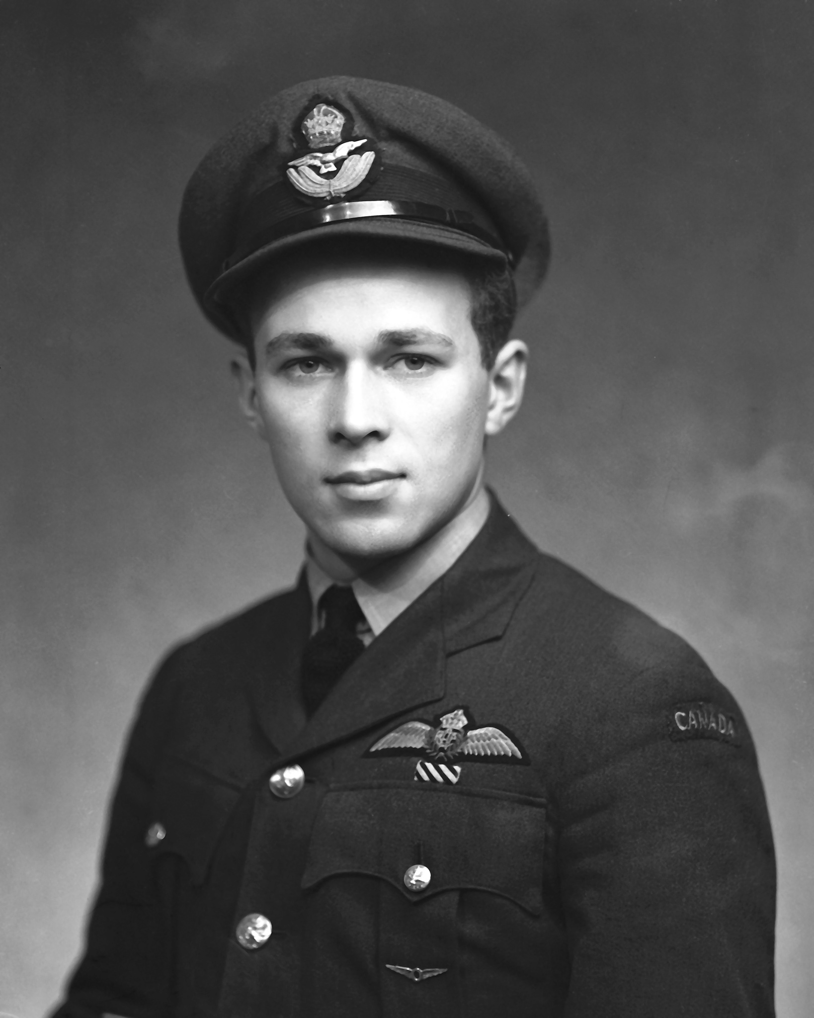A portrait of Flying Officer Richard Rohmer, DFC, of Hamilton, Ontario, taken on January 3, 1945. PHOTO: PL-35523, DND Archives