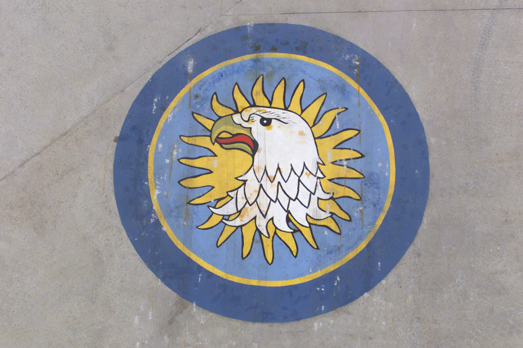 The crest from the 430 Squadron badge adorns the tarmac at Camp Black Bear in Velika Kladusa, Bosnia-Herzegovina, as members of the helicopter squadron serve on Task Force Bosnia-Herzegovina, Rotation 10, of Operation Palladium, Canada's contribution to the NATO Stabilization Force, in August 2002. PHOTO: VK2002-0116-02d DND Archives