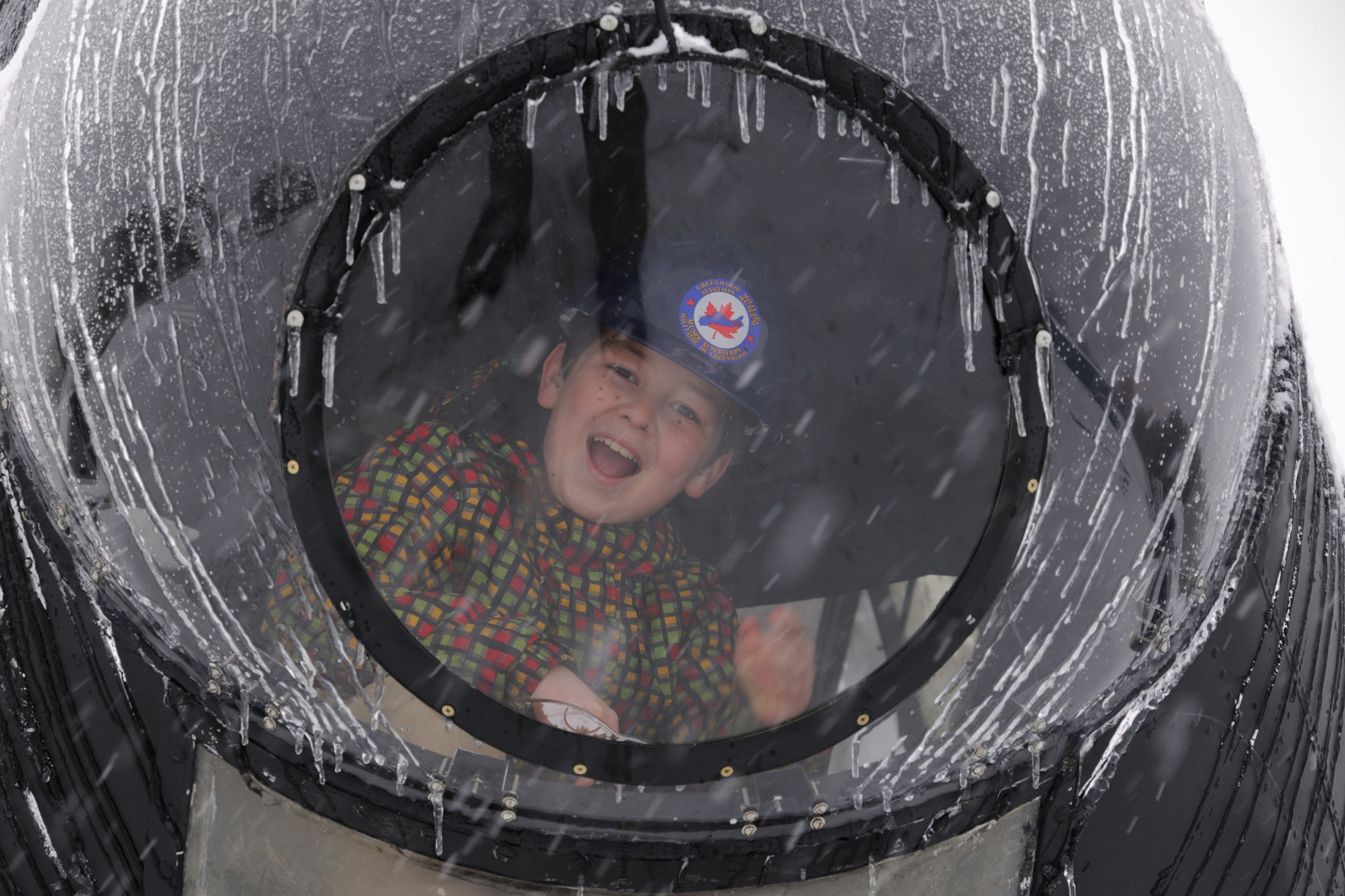 Euan MacDonald can't stop smiling in the nose-cone bubble of the Greenwood Military Aviation Museum's Lancaster bomber. PHOTO: Sergeant Peter Nicholson, GP2016-0019