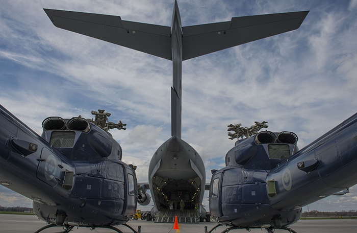 slide - Two Griffon helicopters with a Globemaster aircraft in the background.