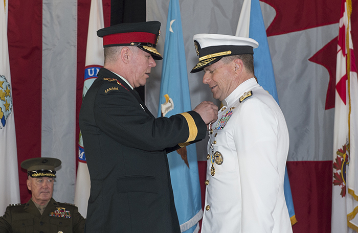 slide - General Jonathan Vance (left) presents the Meritorious Service Cross (Military Division) to Admiral William Gortney,