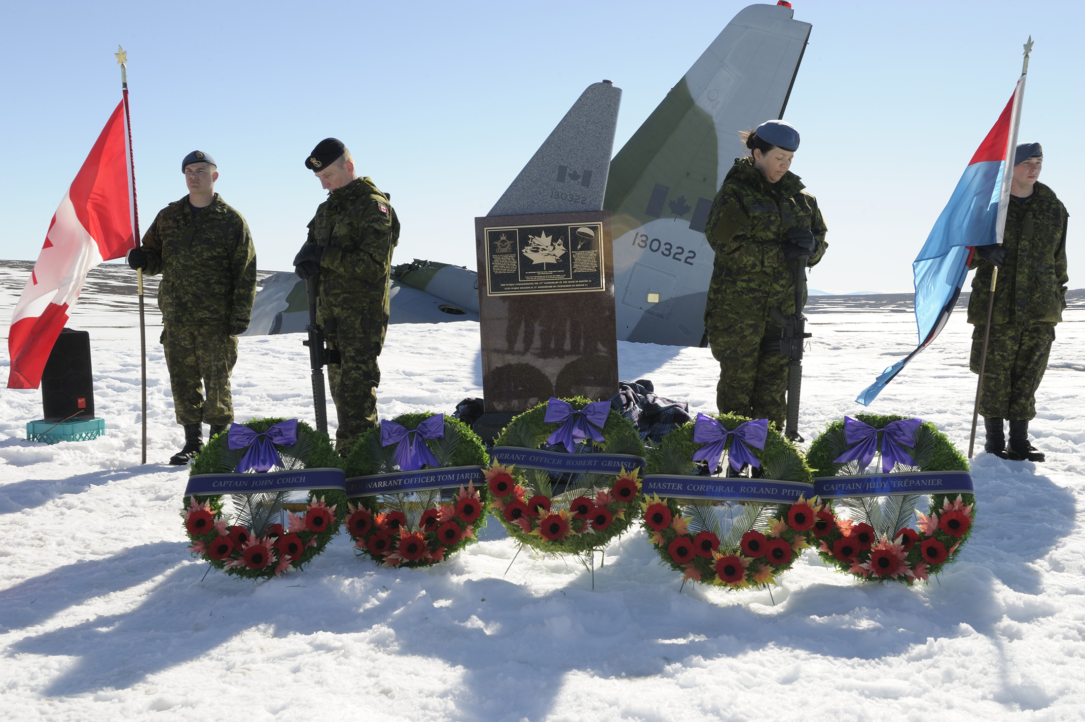 Corporal Brett Guitard (left), Leading Seaman Garnet Robinson, Corporal Yvette Cedeno and Aviator Alain Fortier serve as sentries at the memorial cairn during its dedication.