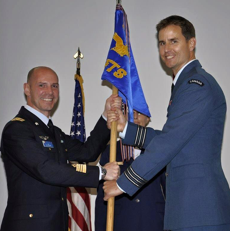 U.S. 80th Operations Group Commander Colonel Paolo Baldasso (left) transfers command of the 89th Flying Training Squadron to Royal Canadian Air Force Lieutenant-Colonel Rhett Chambers.