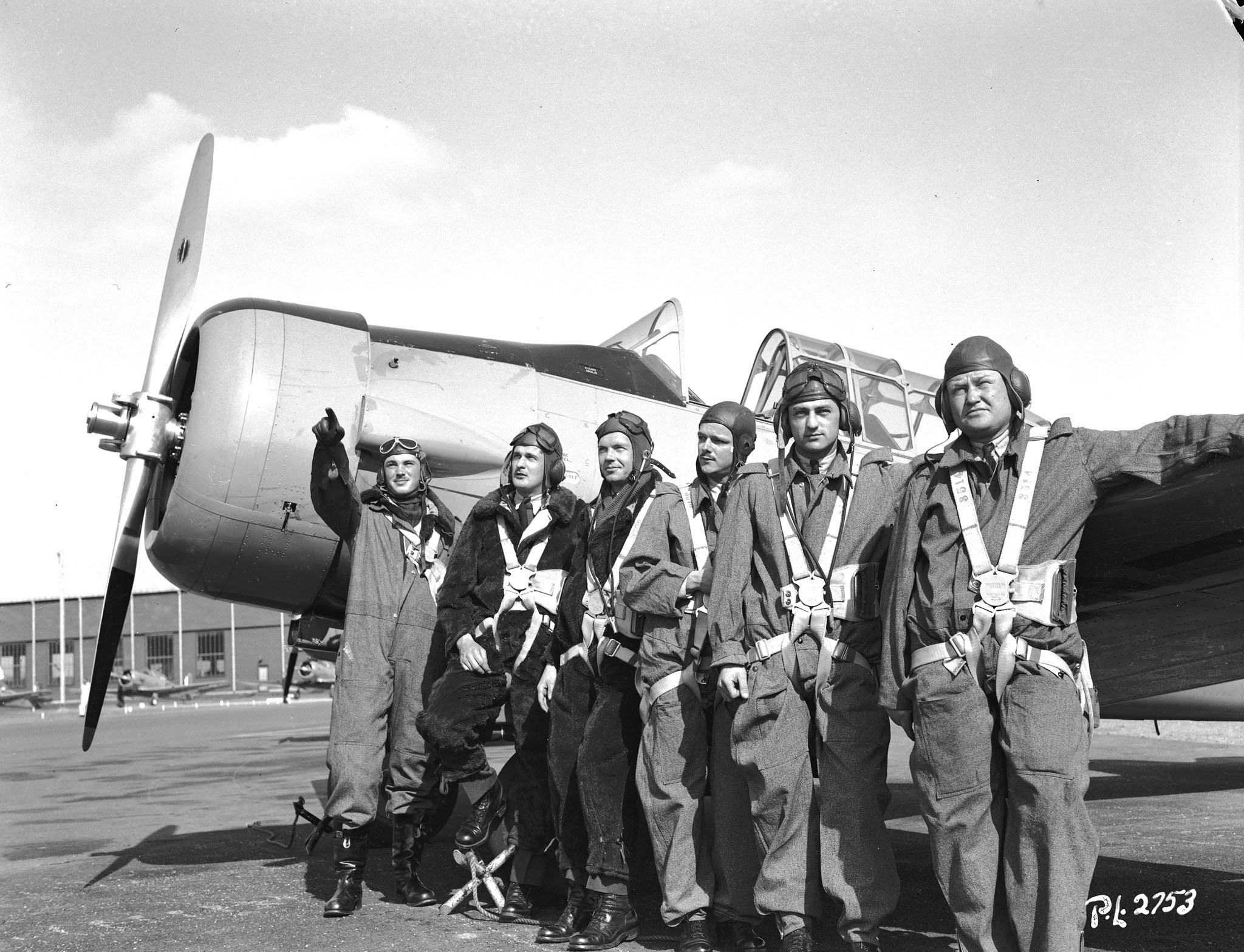 This photo of American airmen, all in the rank of leading aircraftman, was taken at RCAF Uplands, near Ottawa, on April 25, 1941. From left to right: J.G. Magee of Washington, D.C.; A.C. Young of Cleveland, Ohio; C.F. Gallicher of Tulsa, Oklahoma;  C.G. Johnston of Chicago, Illinois; A.B. Cleaveland of Springfield, Illinois; and O.N. Leatherman of Lima, Ohio. PHOTO: DND Archives, PL-2753