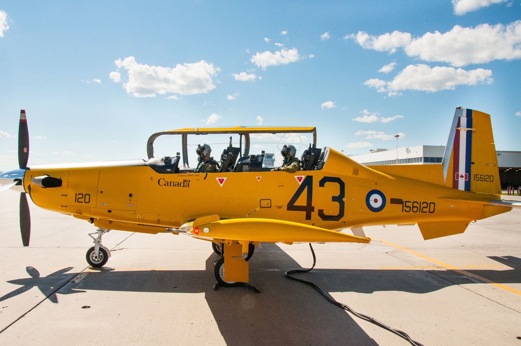 Through the diligent efforts of many, and in cooperation with NATO Flying Training in Canada (NFTC) program partner, CAE, the aircraft has been painted in a yellow Second World War British Commonwealth Air Training Plan paint scheme to commemorate the Plan. PHOTO: DND