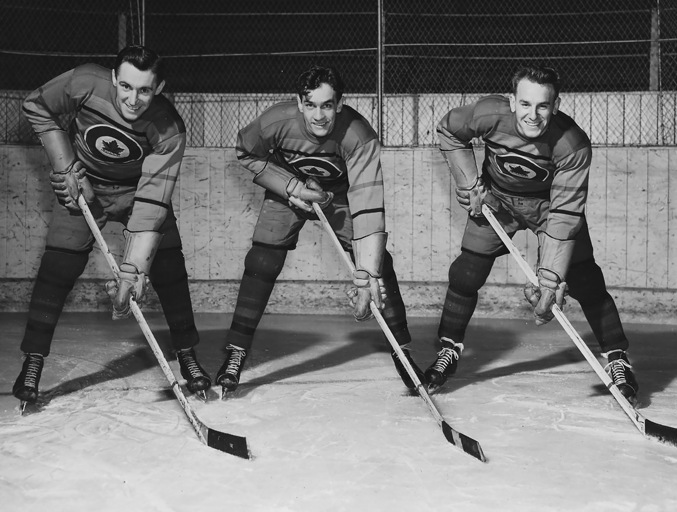 Ab Renaud (left), Ted Hibberd and Reg Schroeter strike a pose for their 1948 RCAF Flyers players card photograph. PHOTO: Courtesy of Tim Schofield